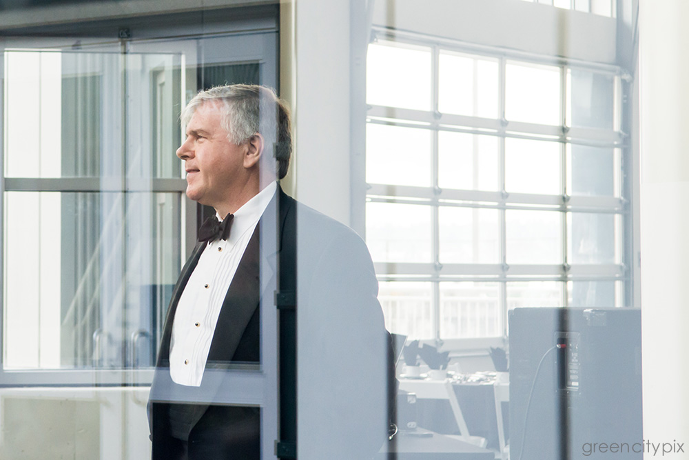 Father of the bride: This photo was taken while we were waiting for everyone else to get to the reception in Bell Harbor.   I like how the various patterns are reflected through the window.