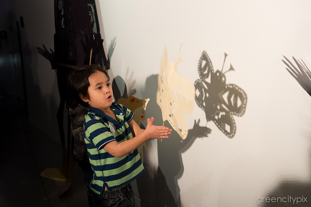 Playing with shadow puppets.