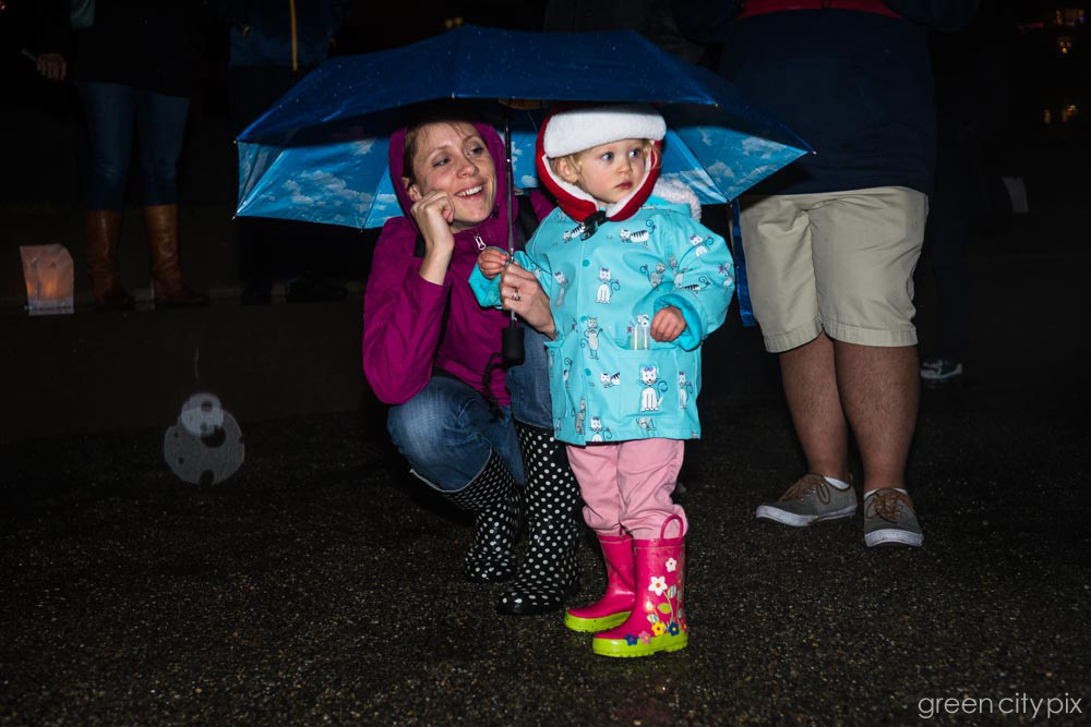 This duo gets the award for sporting the cutest rain gear in town.