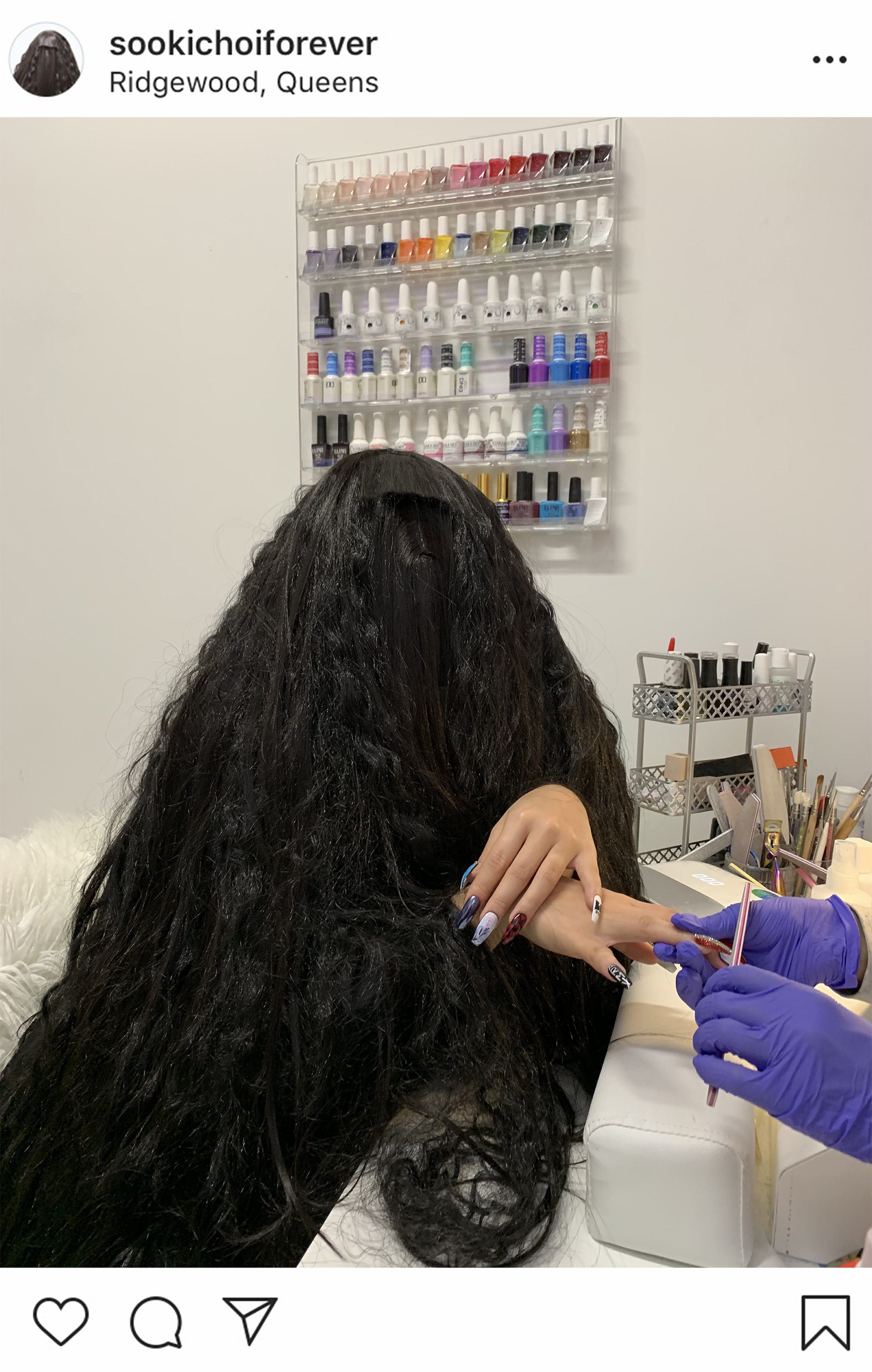 As a nail enthusiast, Sooki likes to get her nails done and share them with her followers. Sooki is always cognizant of the latest trends and cultural phenomenons. In this photograph, she is getting her nails done in a private salon, with pictures of the Korean band BTS imprinted on them.
