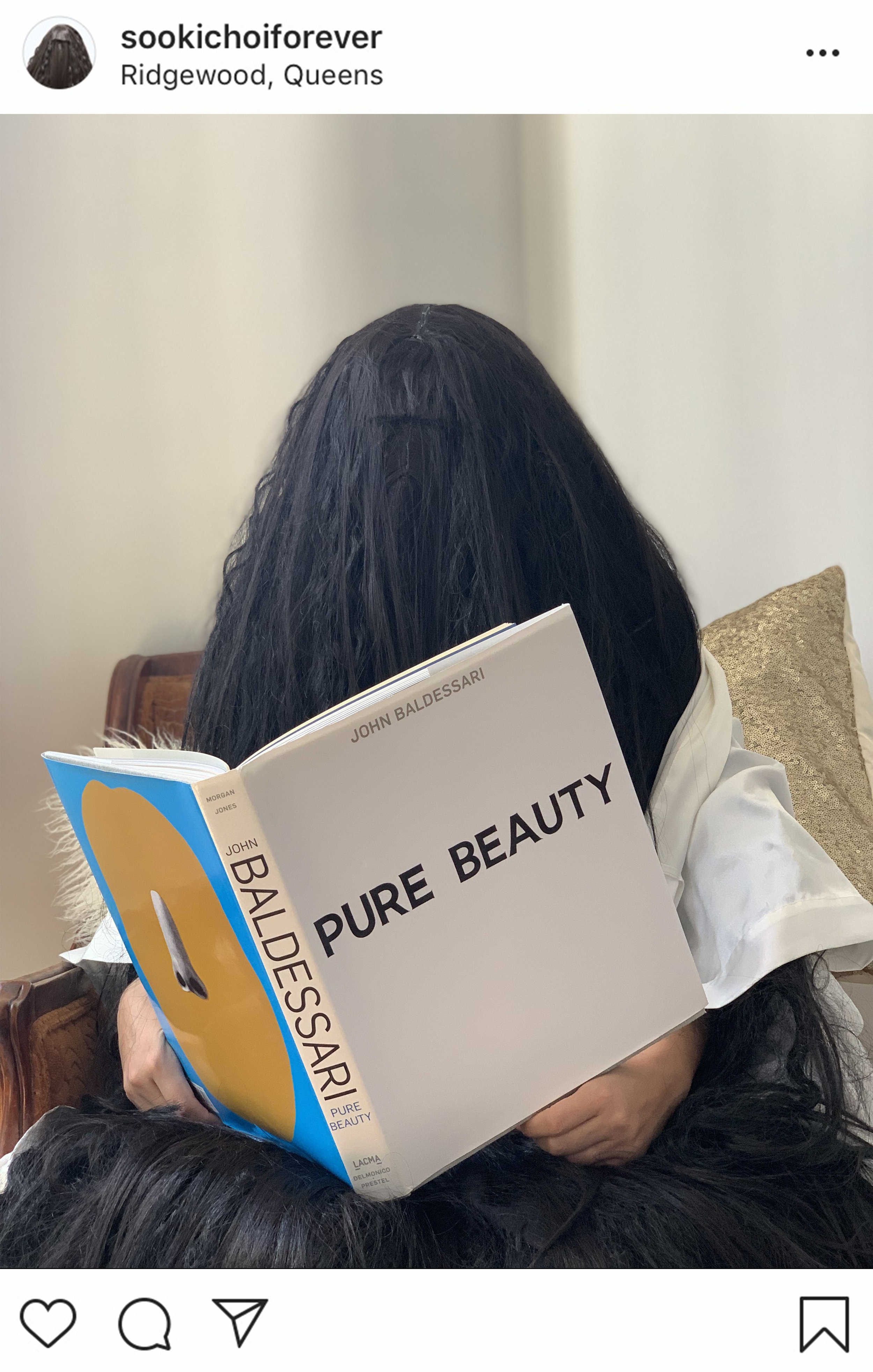 On her free time, when she is not getting her nails done or meeting up with friends for brunch, Sooki likes to catch up on her reading. Here she is sitting in her bedroom on a Saturday afternoon reading a book titled Pure Beauty.