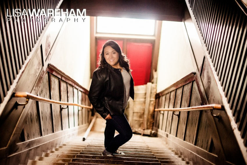 Old, historic buildings in Uptown Butte add a lot of interest to senior portraits. We love this epic staircase with Tristan standing in the middle.