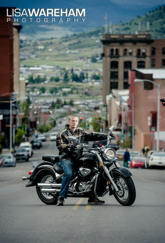 """Connor parks his Bike in the middle of Main Street in Uptown Butte. Motorcycle + oncoming traffic = """"Evel"""