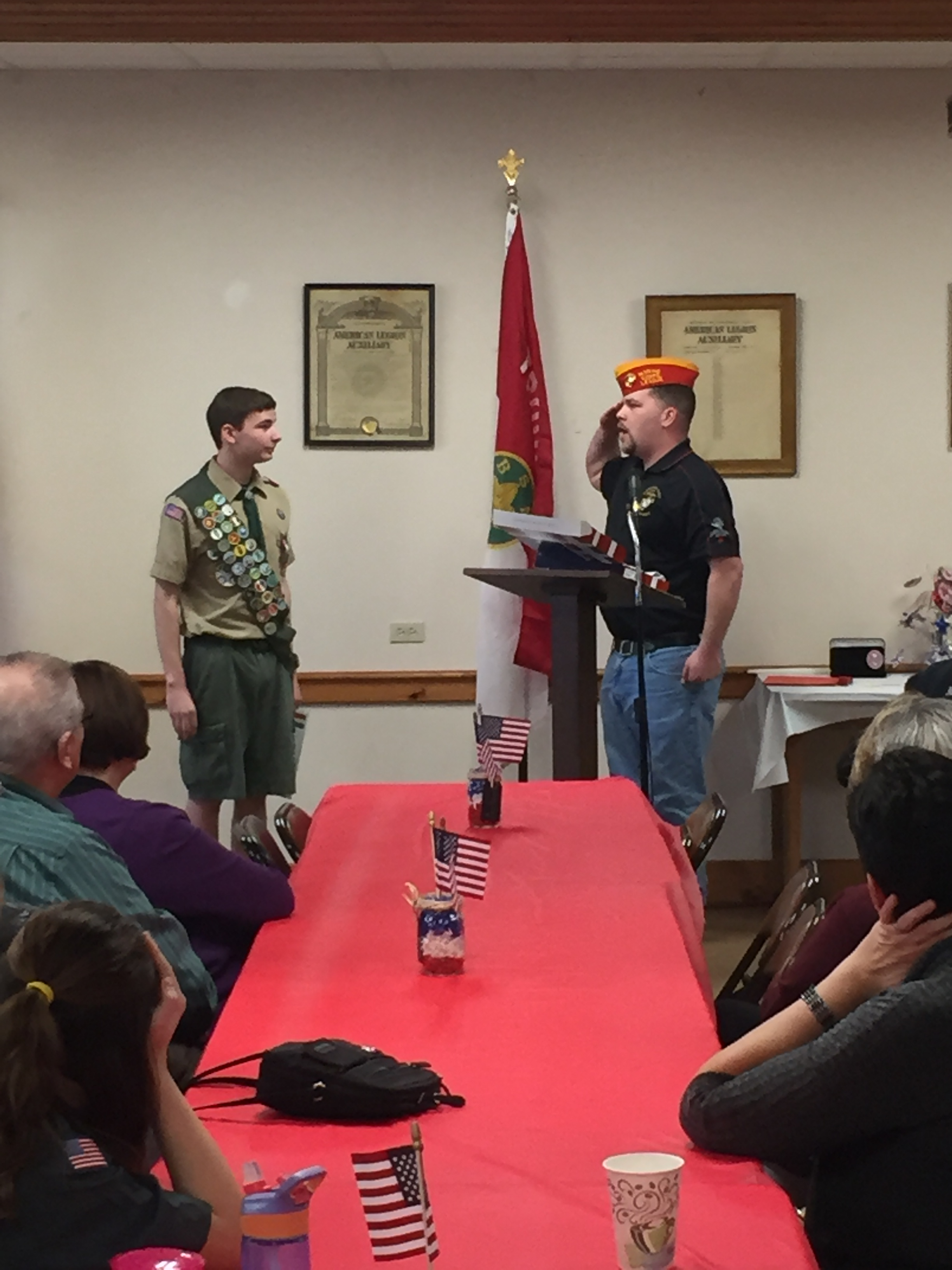 Commandant Smith paying tribute to a young man during his Eagle Scout Court of Honor.
