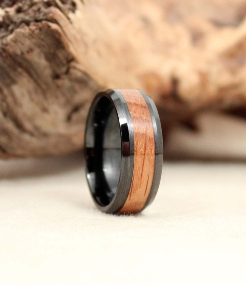 Whiskey barrel oak flanked by practically unscratchable and non-conductive black ceramic.