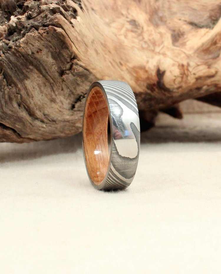 Hand-wrought Twisted Damascus Steel and Bourbon Barrel Wood Ring