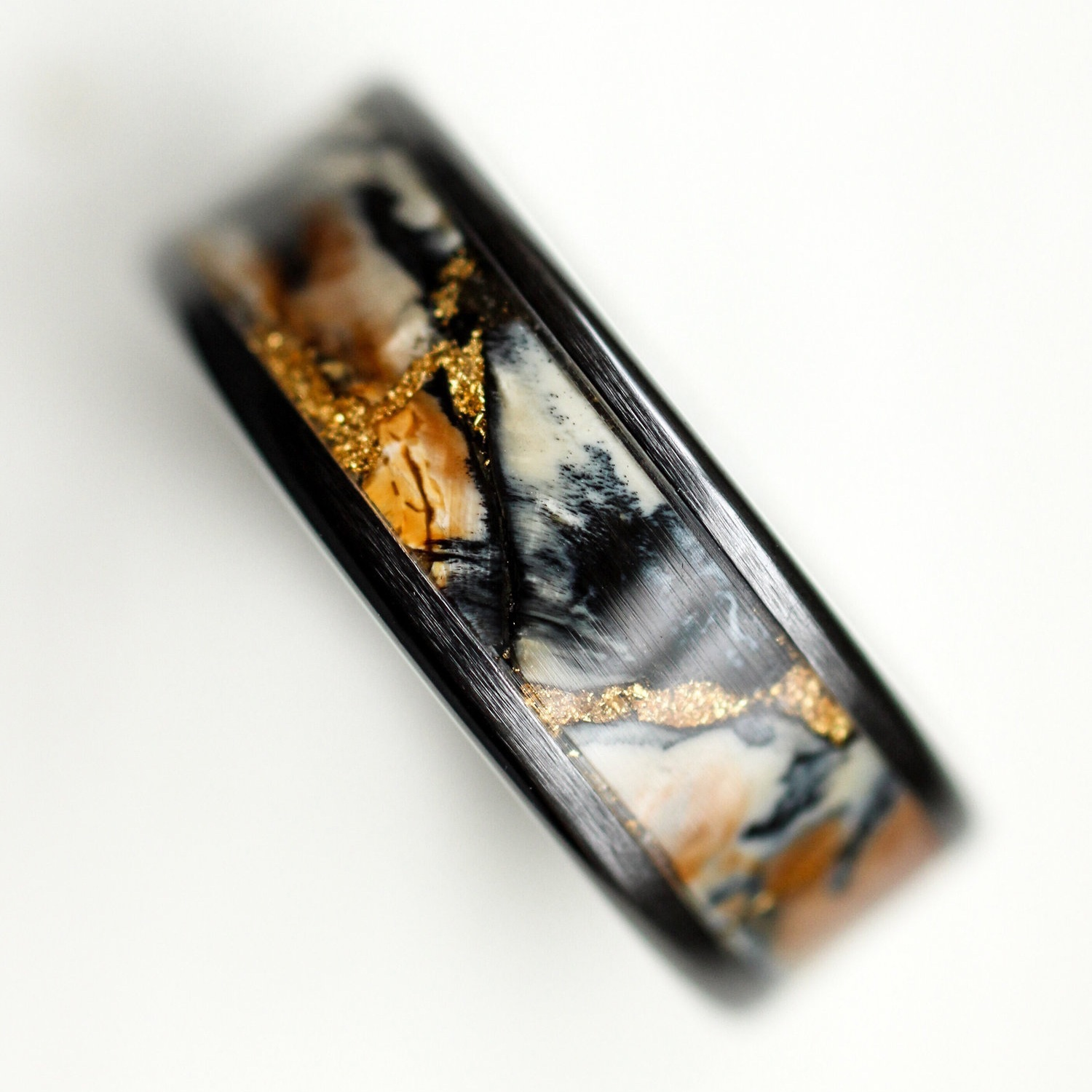 mammoth-tooth-gold-black-ceramic-ring-wedgewood.jpg