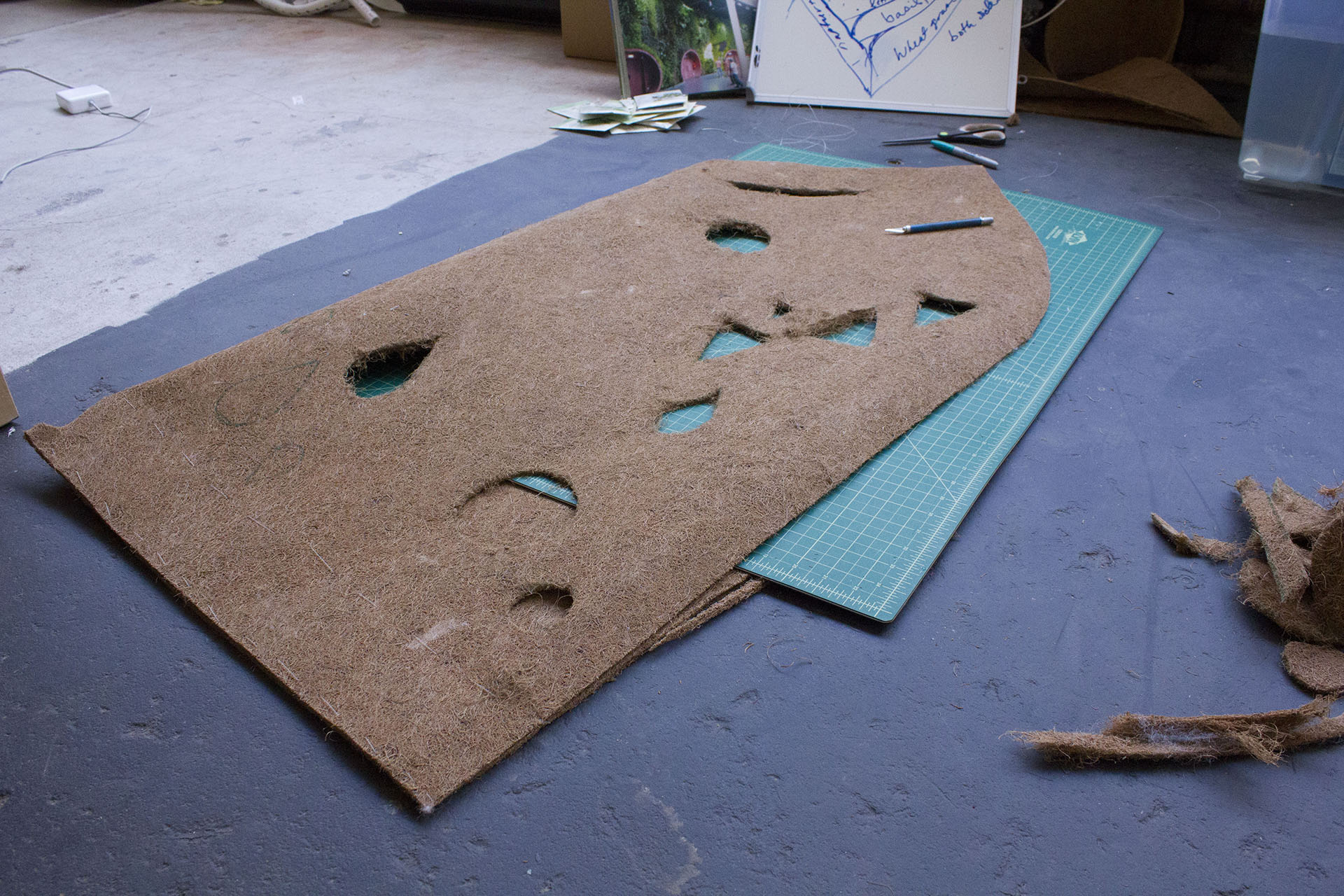 Cutting out the coco husk fiber mat for Green Flag