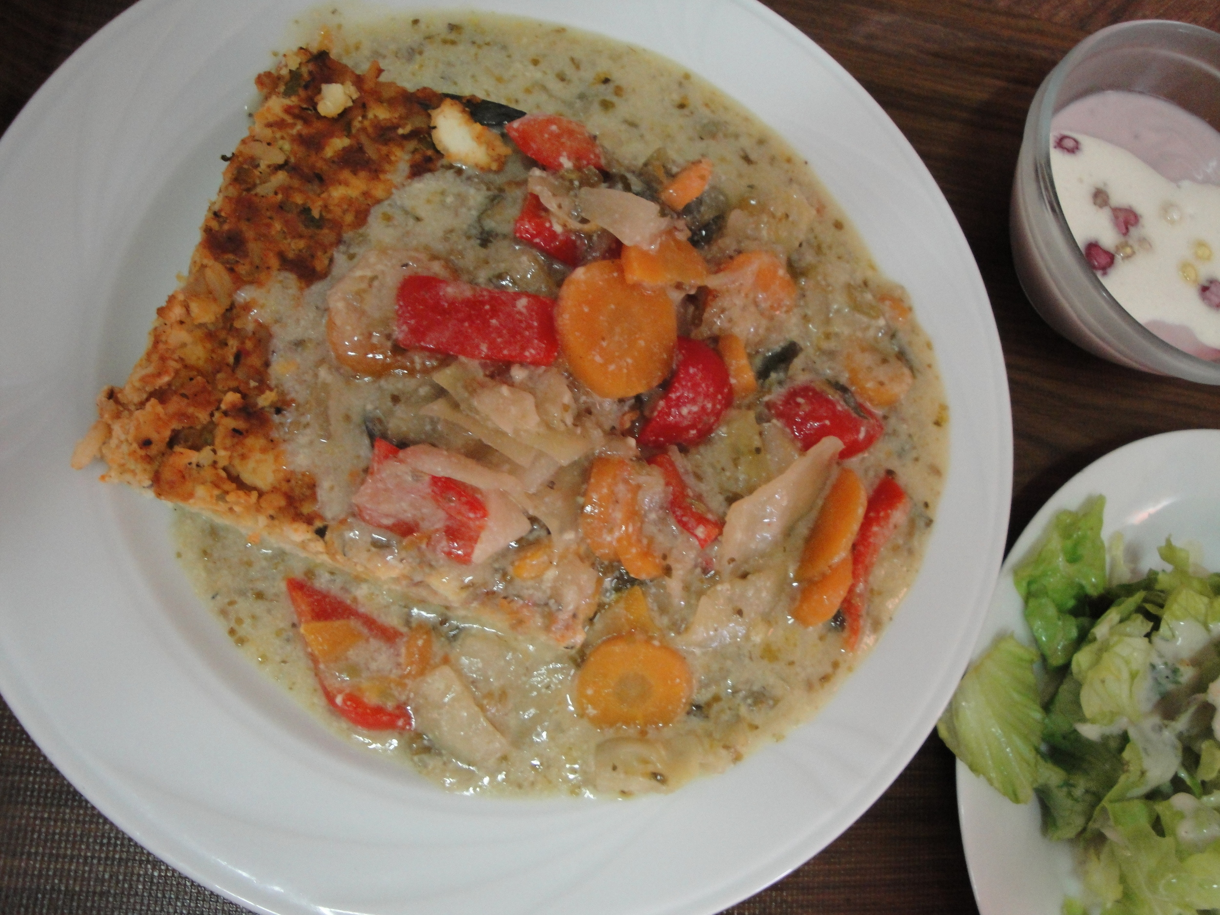 Millet slice with tofu crust and summer vegetables in soy cream sauce.......