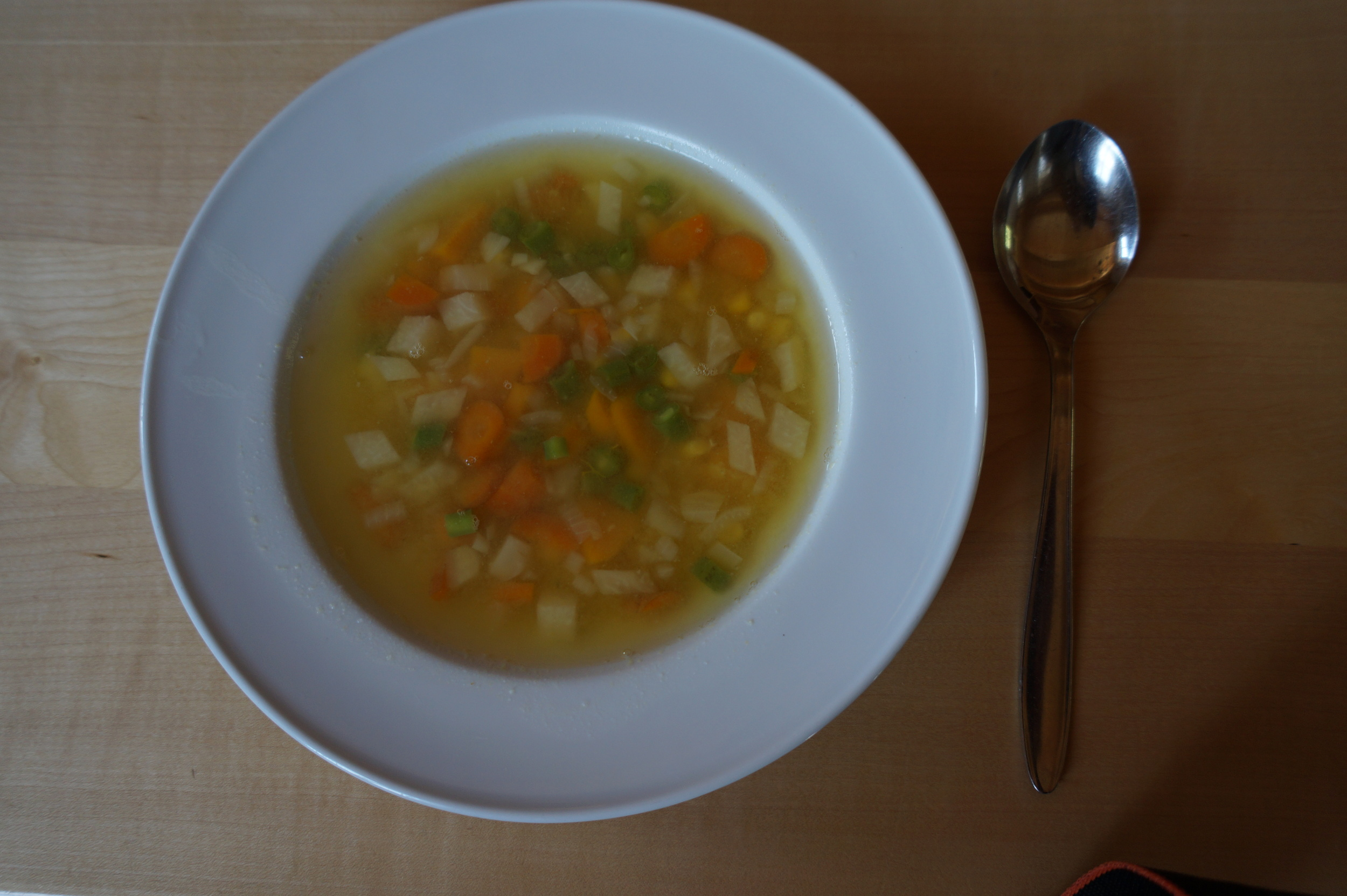 Light vegetable soup for lunch with a touch of red lentils.