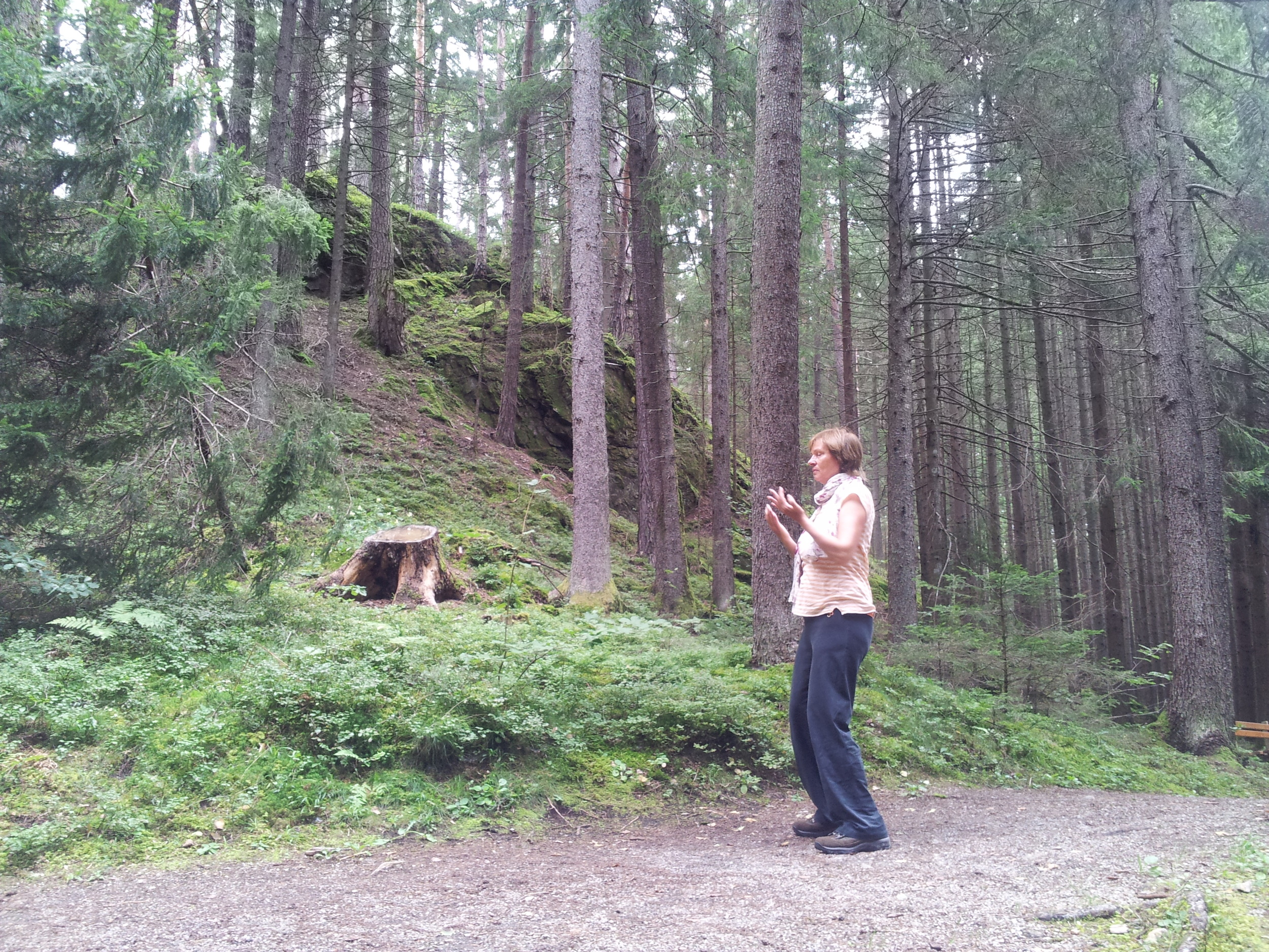 mum doing qigong in the forest