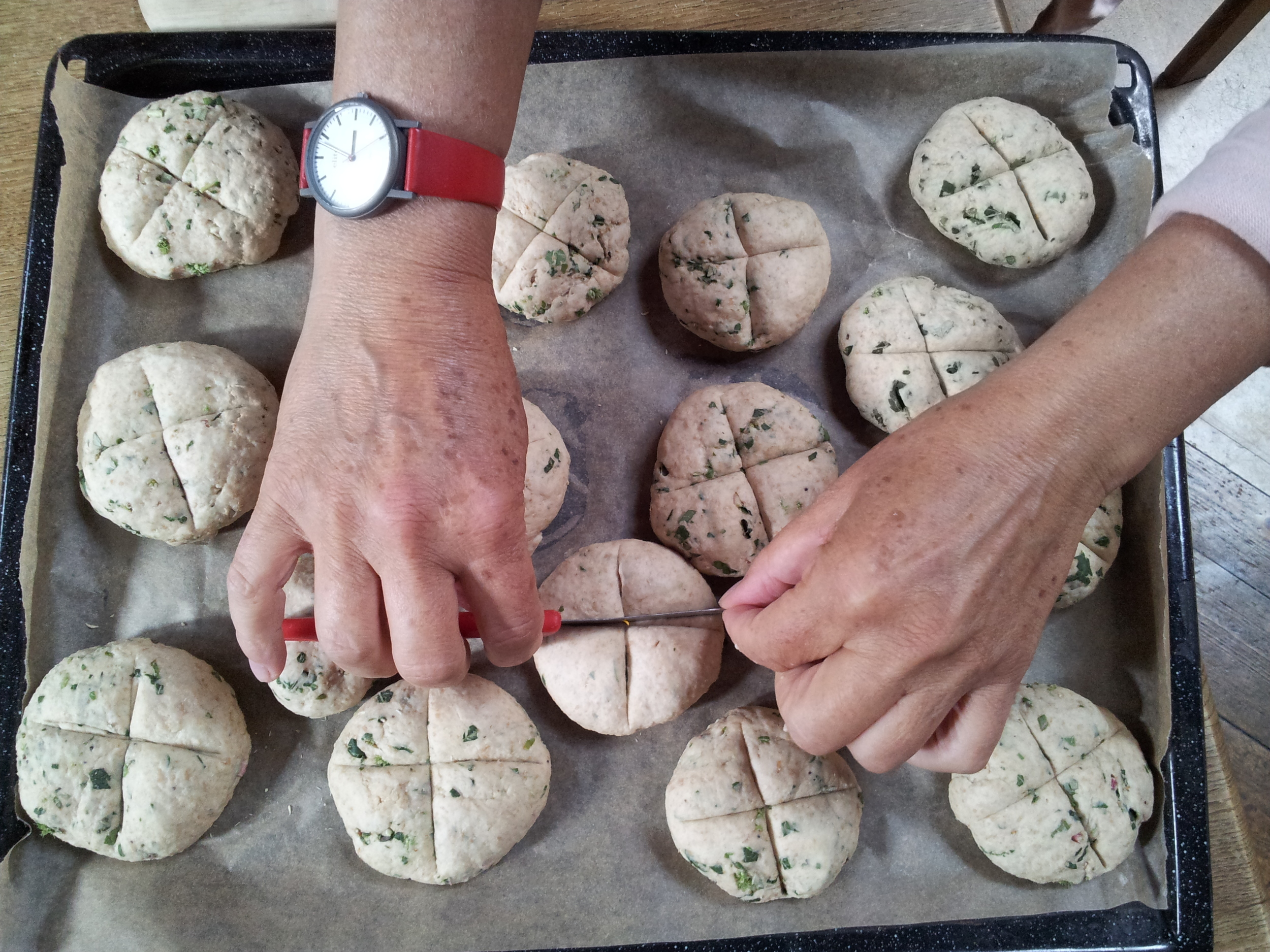 crazy wild-herb filled spelt breads! Here mum doing a really neat job adding crosses
