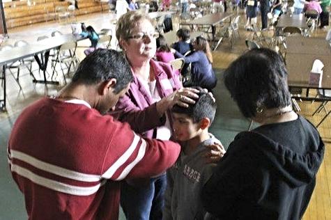 Family praying over kids.jpg