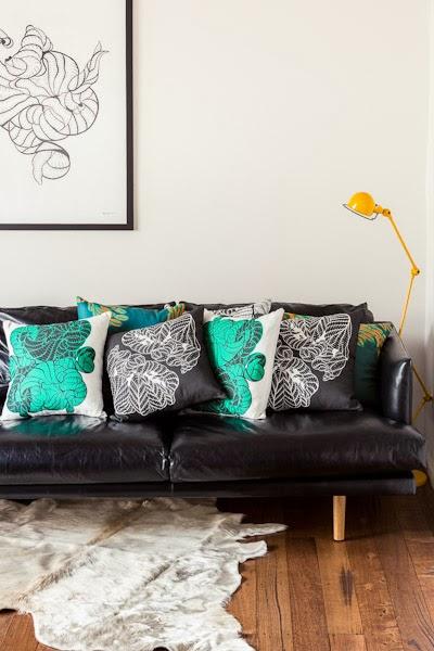 Sarah_Anderson_Photography_Maja_Creative_sofa_cushions_rug_painting_wooden_floorboards