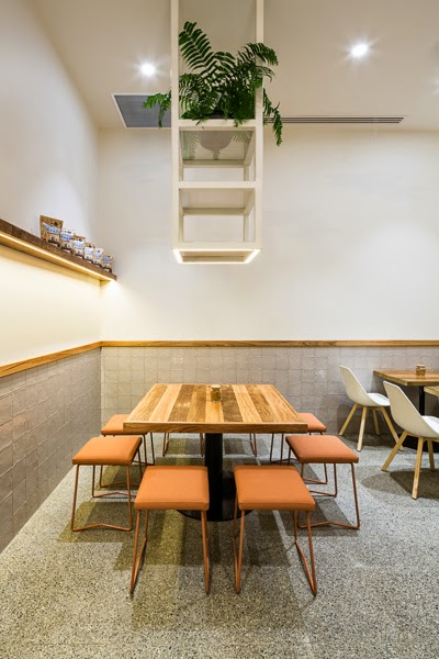seating and indoor plants at the Waffee store