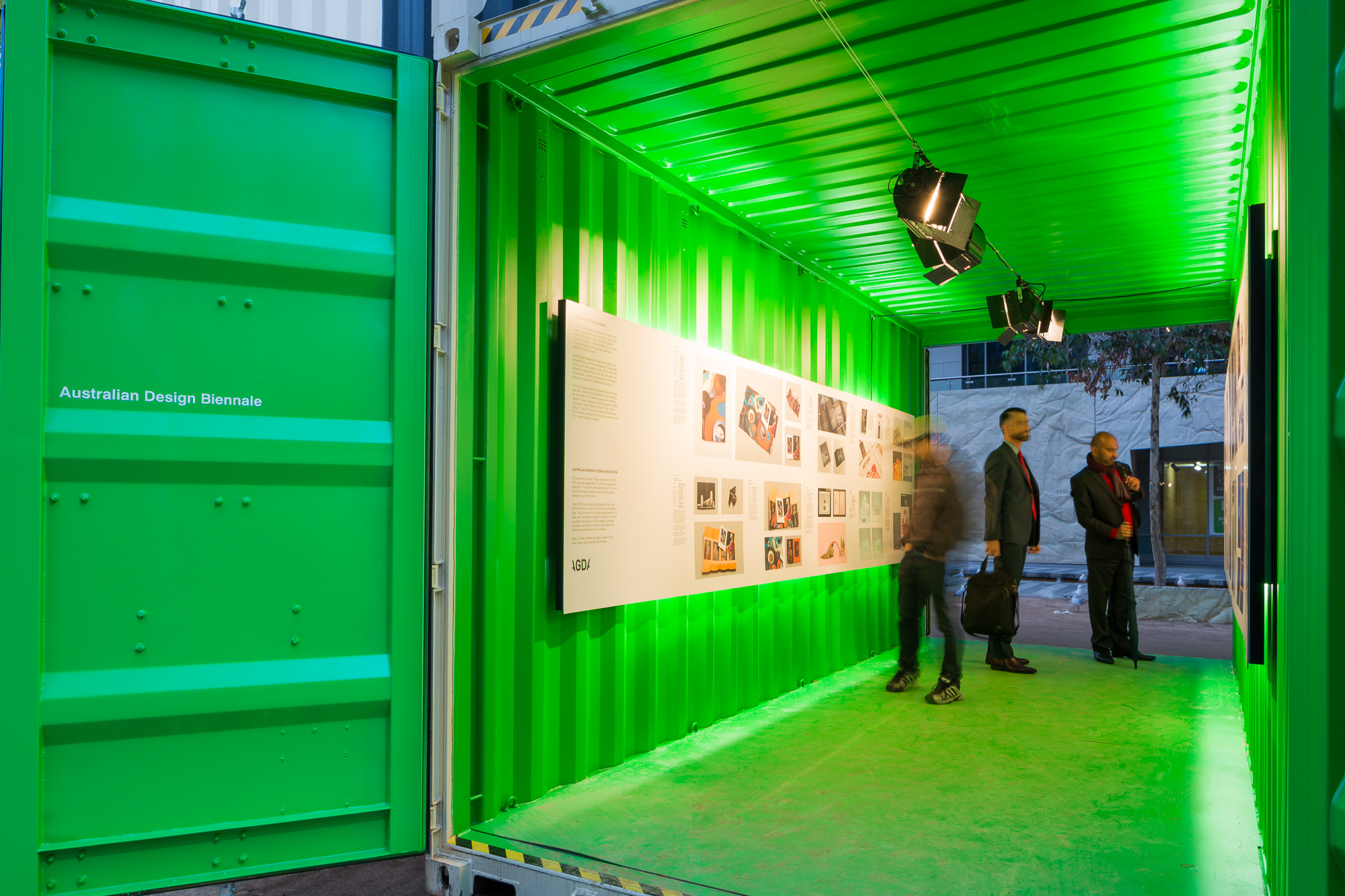 MIDW15_city_square_exhibition_with_green_shippling_containers_at_night_photography_by_sarah_anderson