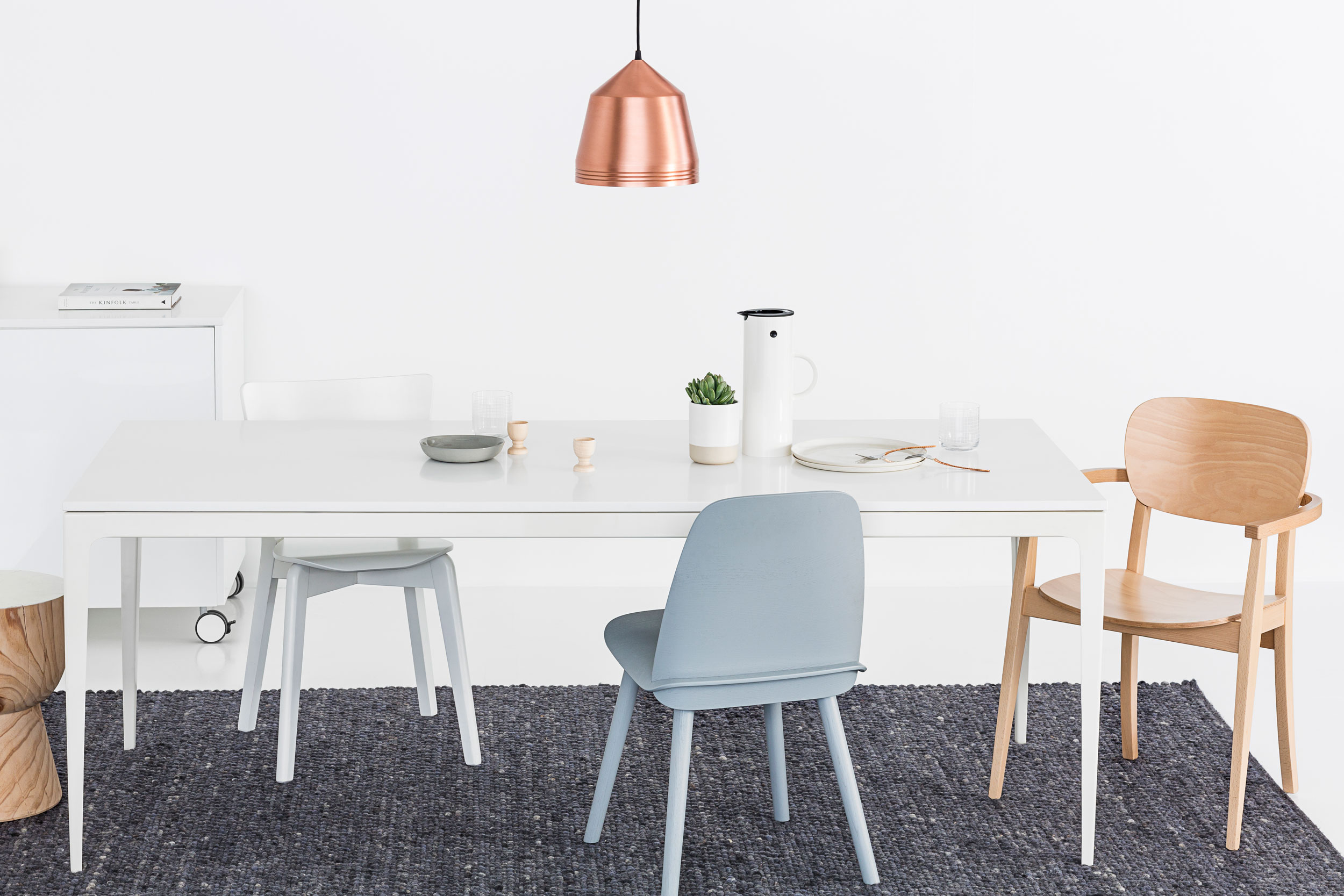 Urbi_table_stone_white_cesarstone_mutto_chairs_sarah_anderson_photography