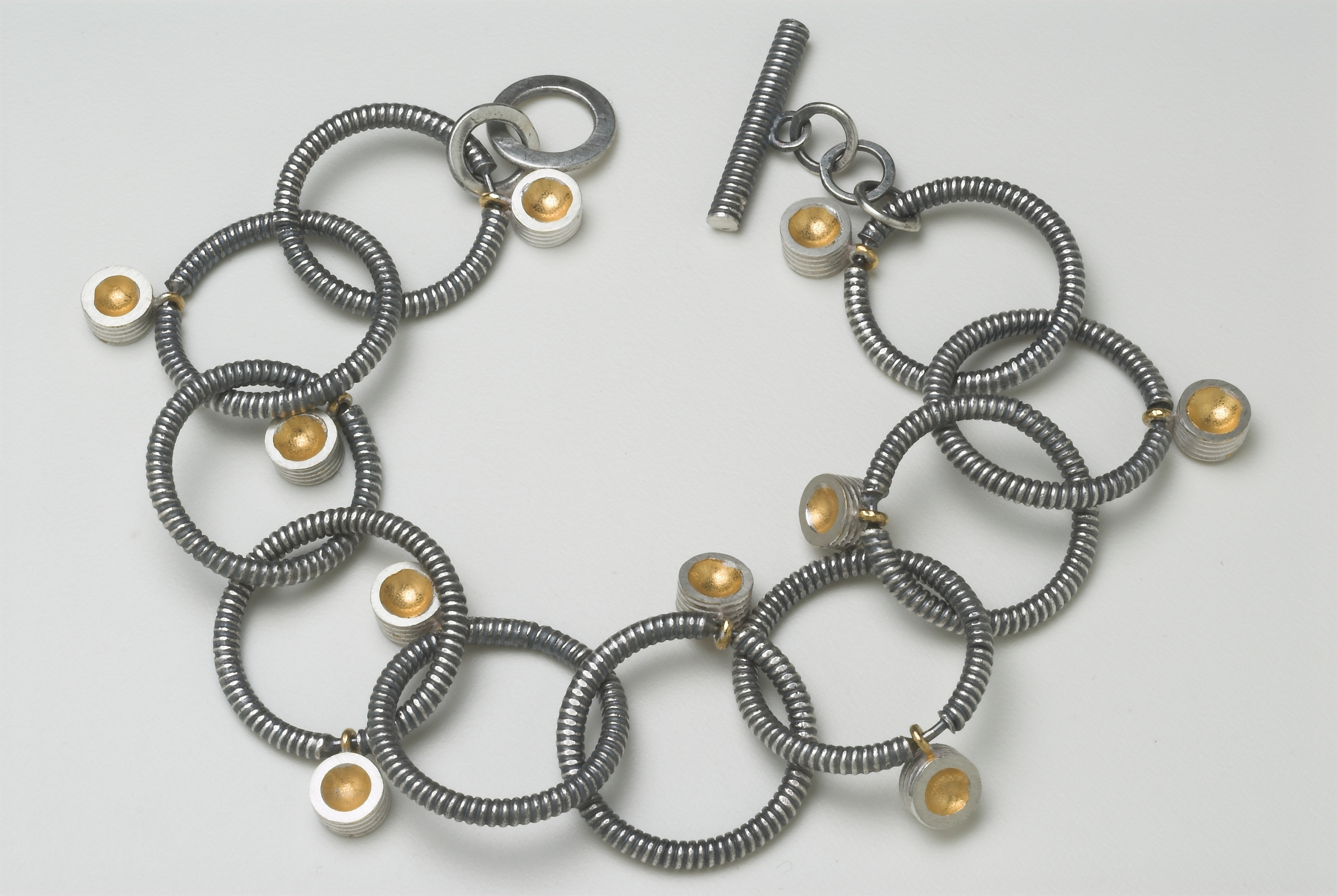 3. Oxidised silver and gold plate bracelet. £370