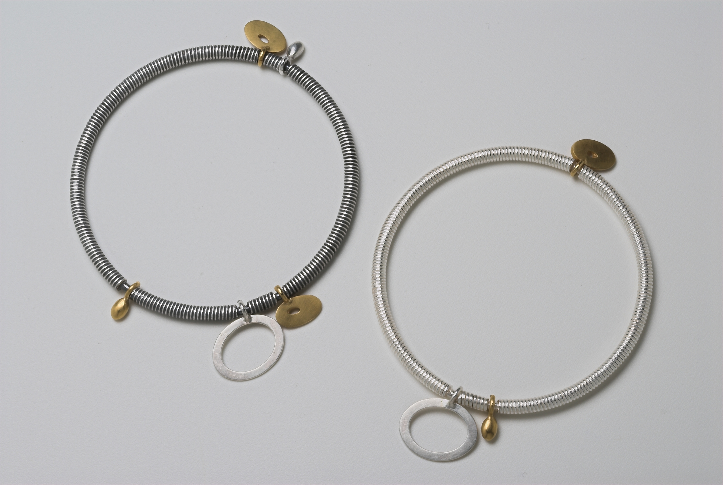 1.Silver and gold plated bangles £250
