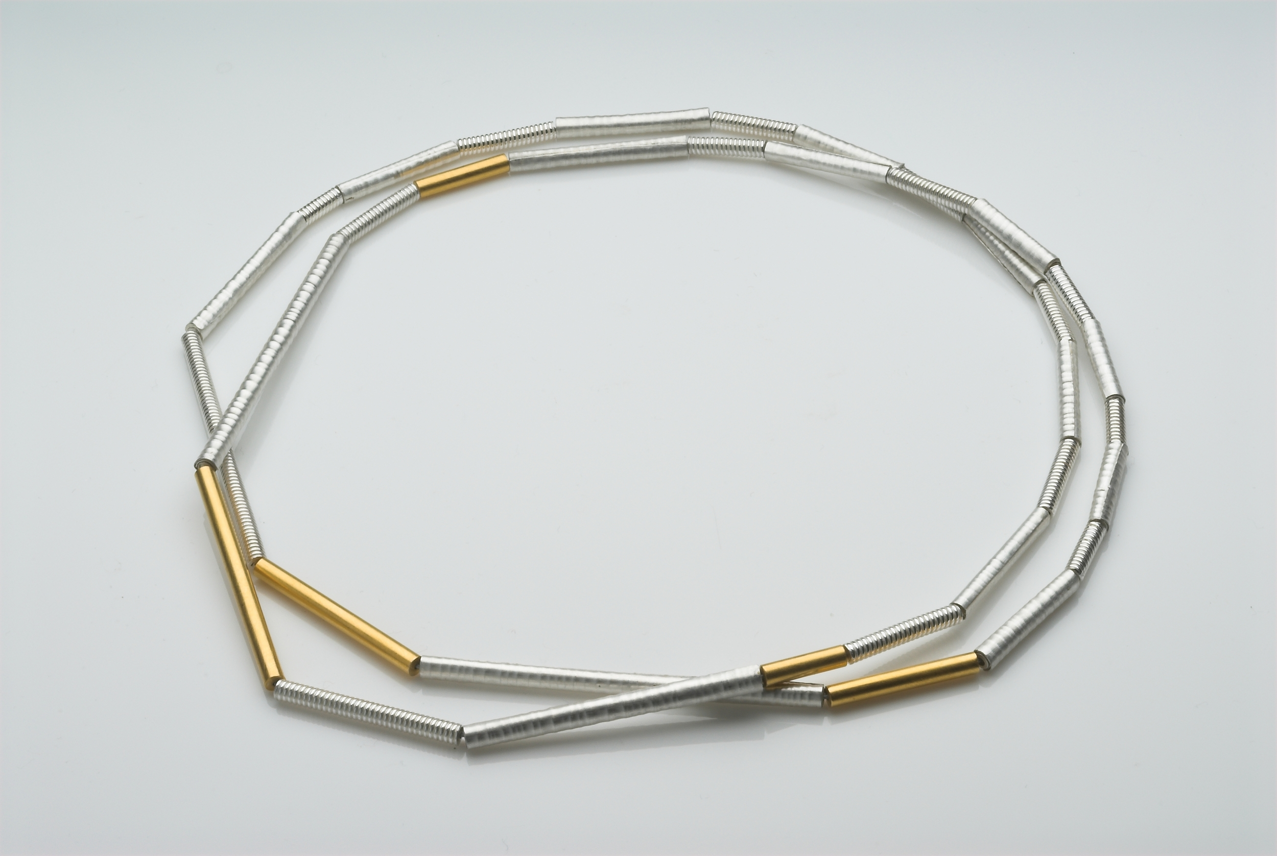 Fine tube necklace,silver and gold plate