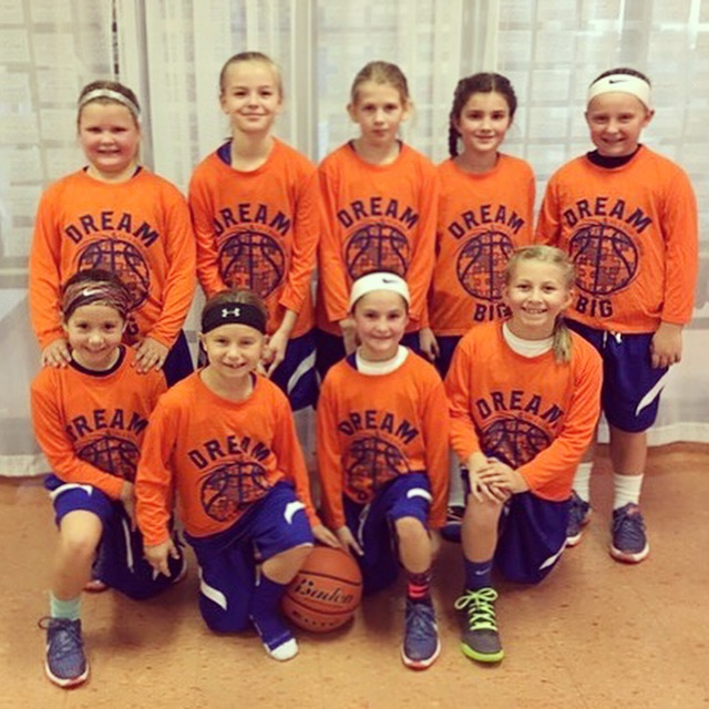 """""""No Limit"""" travel basketball team helping us out with their sweet looking orange & blue """"Dream Big"""" shirts!"""