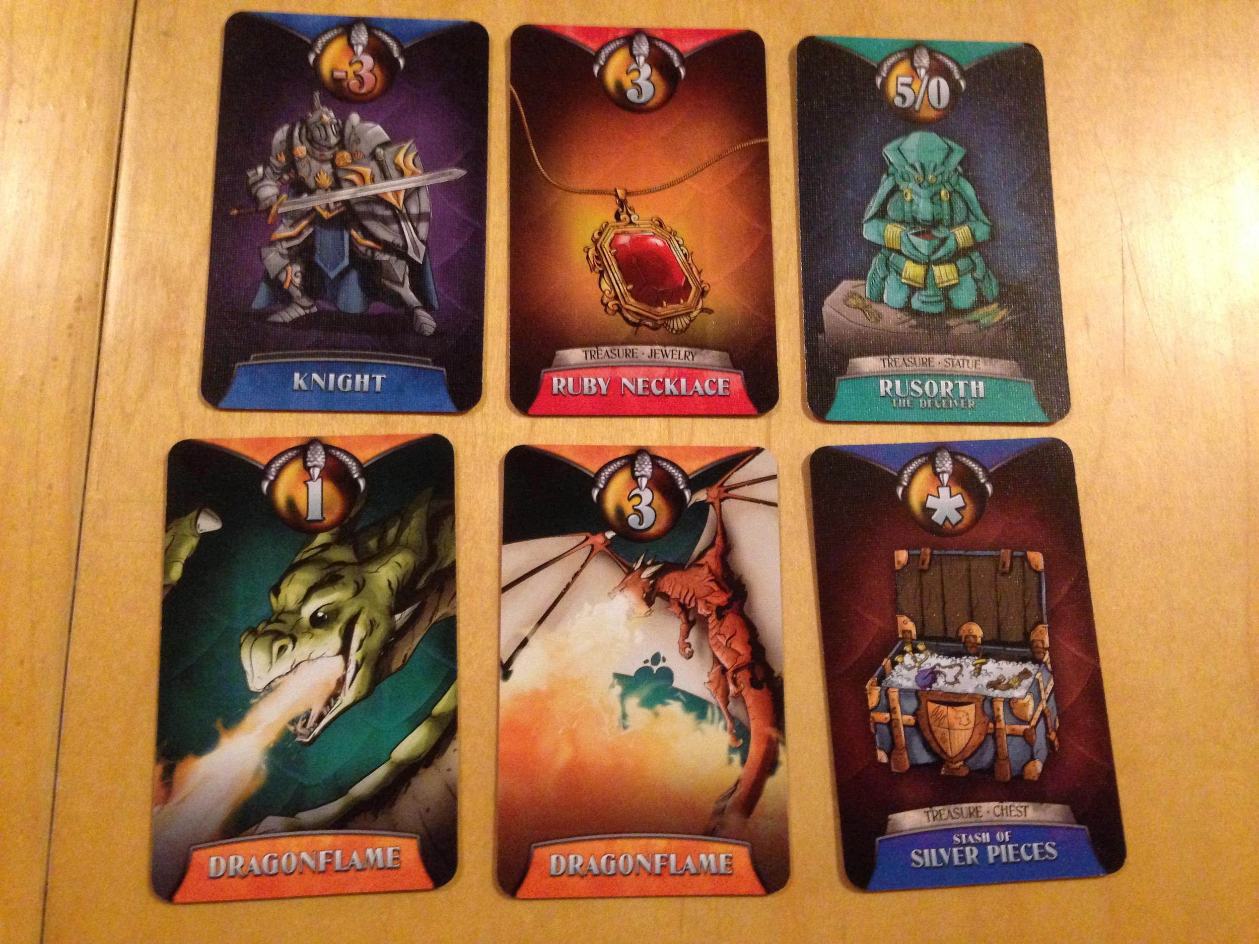 Some Treasure cards. Note the Knight who costs you points. BAD KNIGHT!