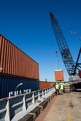 Containers being loaded onto barge