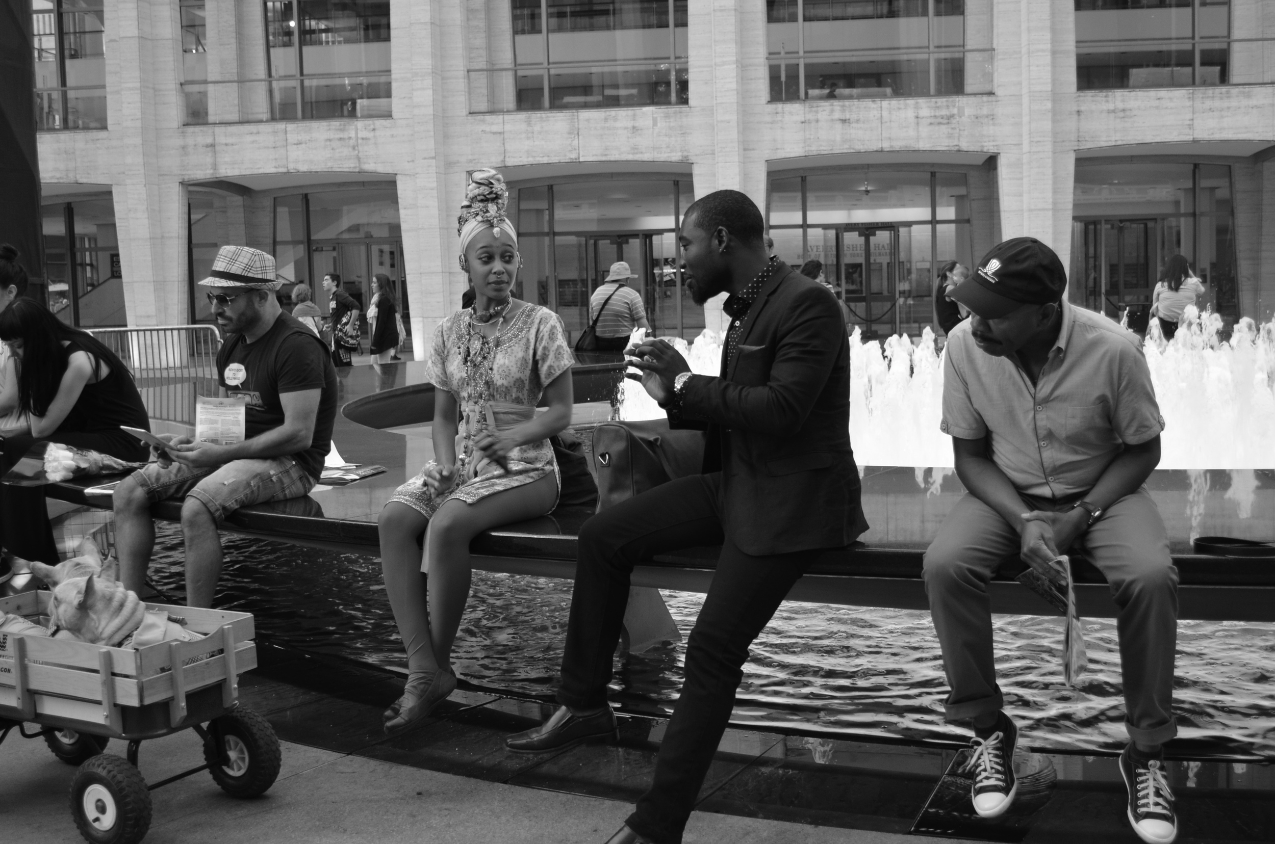 One lady, three men at Lincoln Center - New York Fashion Week.