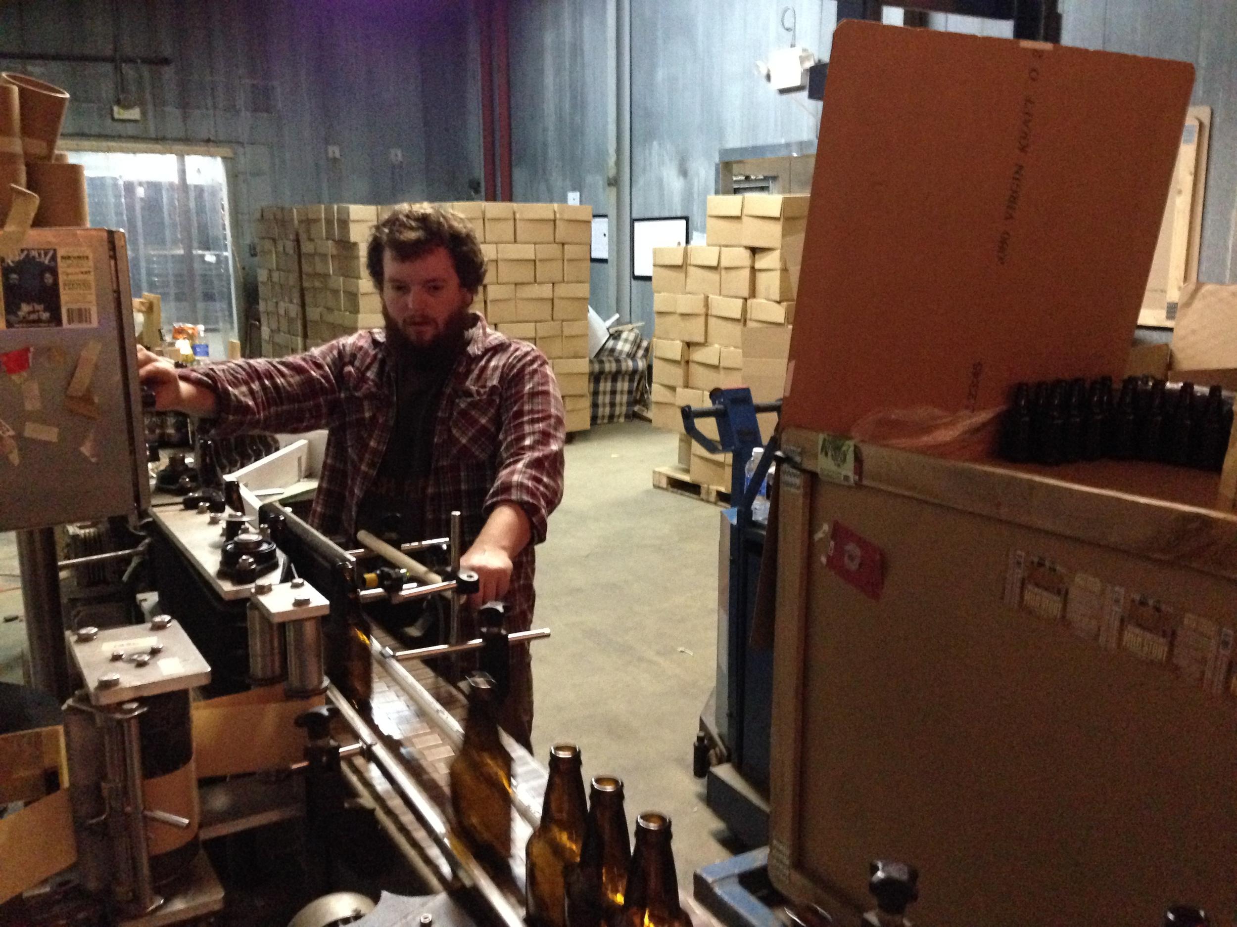 Danny labeling our bottles