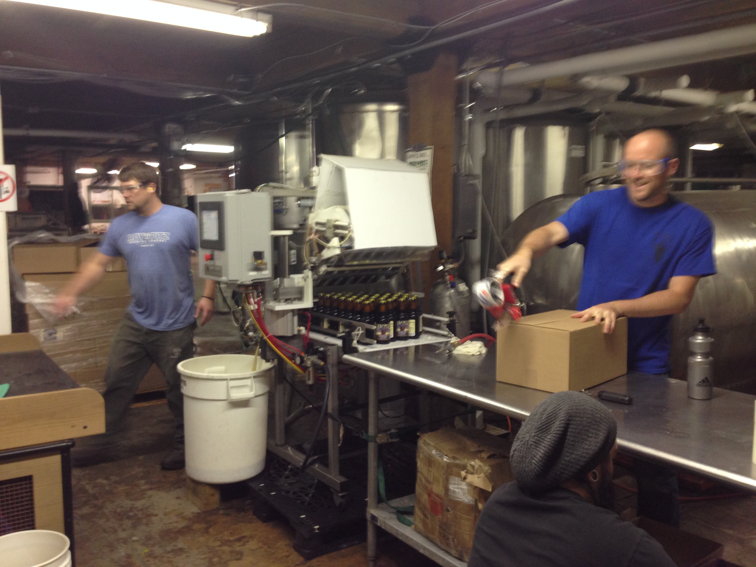 Roy, Chris and Berto filling the bottles