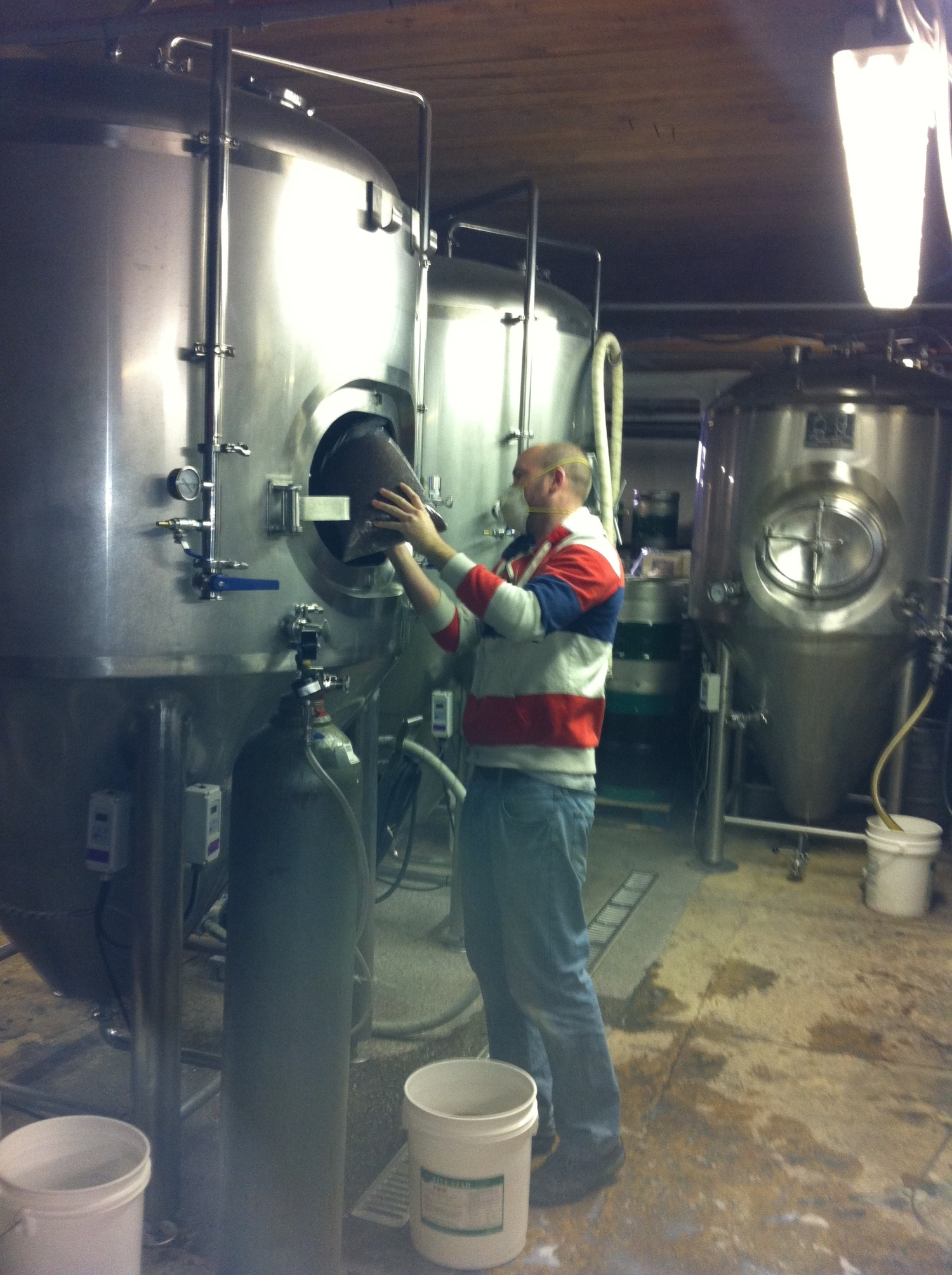 Chris adding cocoa nibs to the Chicken Leg Oatmeal Stout