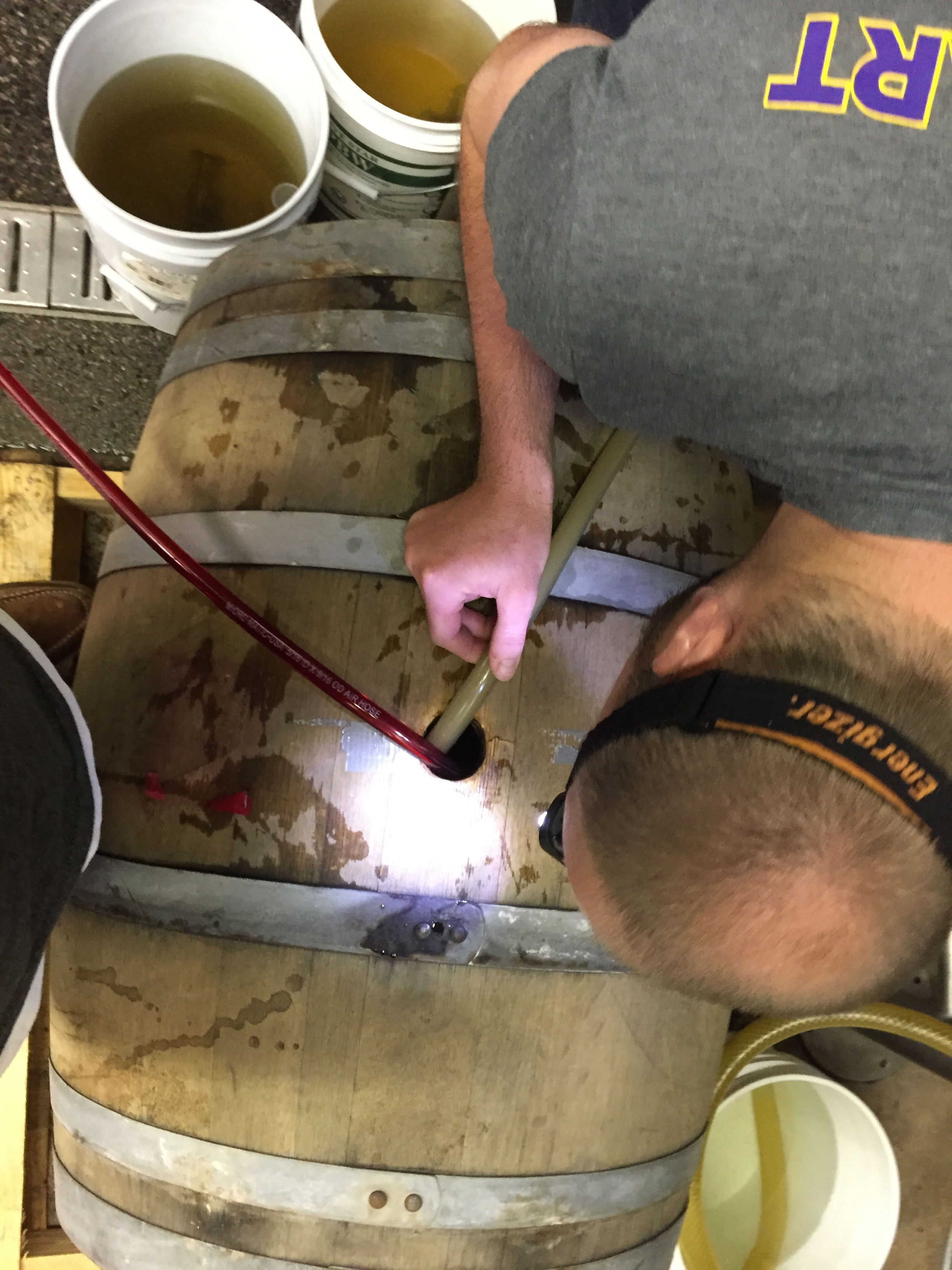 Chris filling a used white wineoak barrel from California with our Sour Hound!!