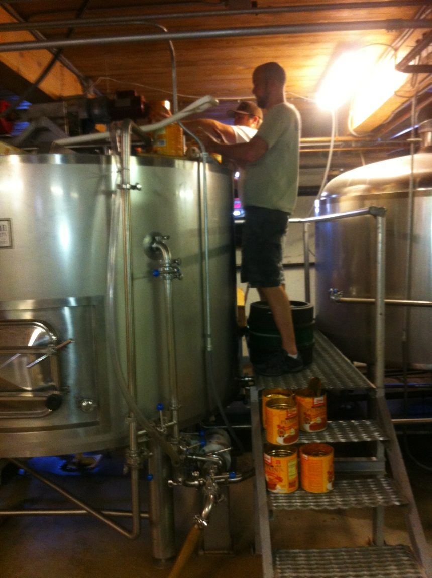 Chris and Ryan adding pumpkin to the mash tun for Ichabod's Midnight Ride.