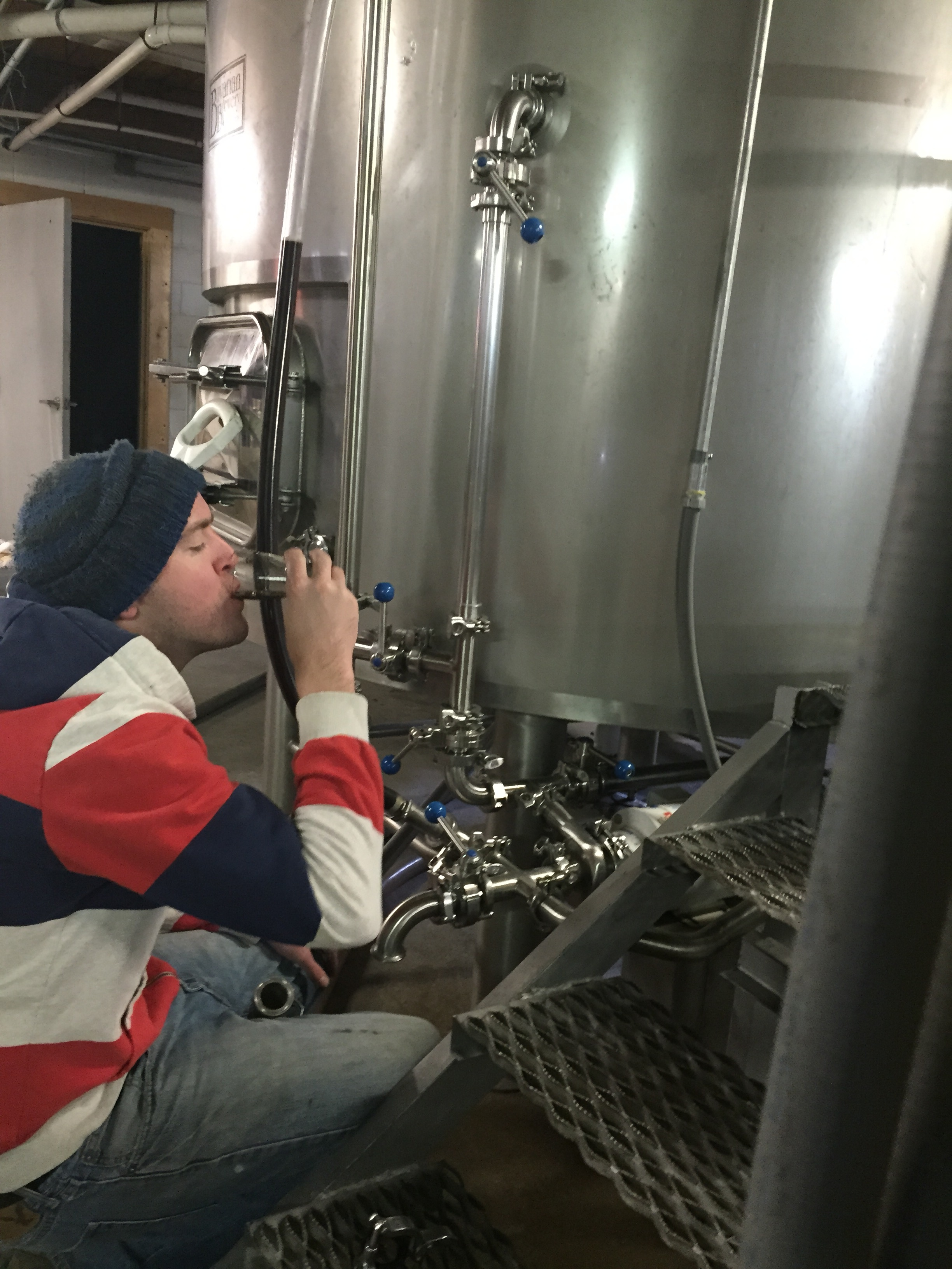 Brewer Chris sampling the wort from the Safety Stout!