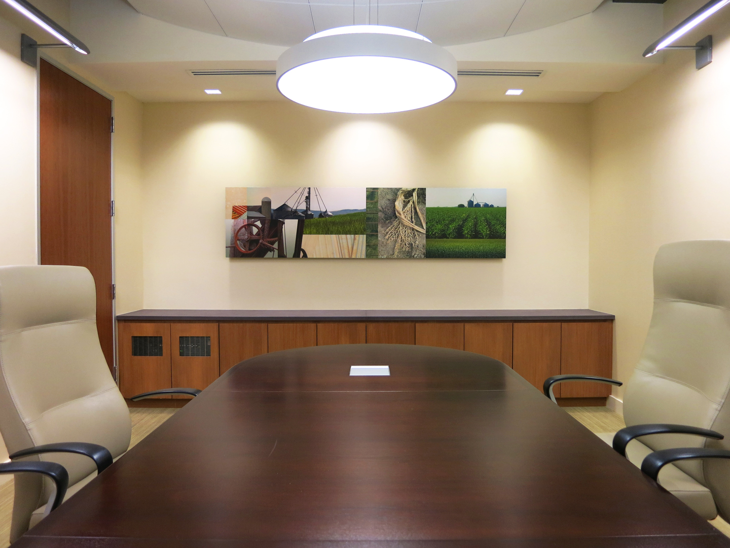 A Conference Room features a custom photo collage above the credenza.
