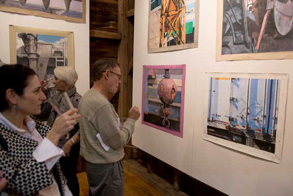 Guests take a closer look at Val's works.