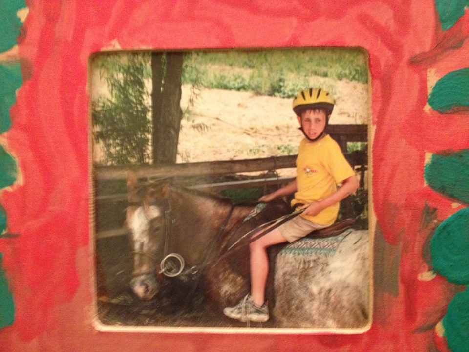 Embarrassing childhood photo: 9 year old Andrew displays his passion for horseback riding.