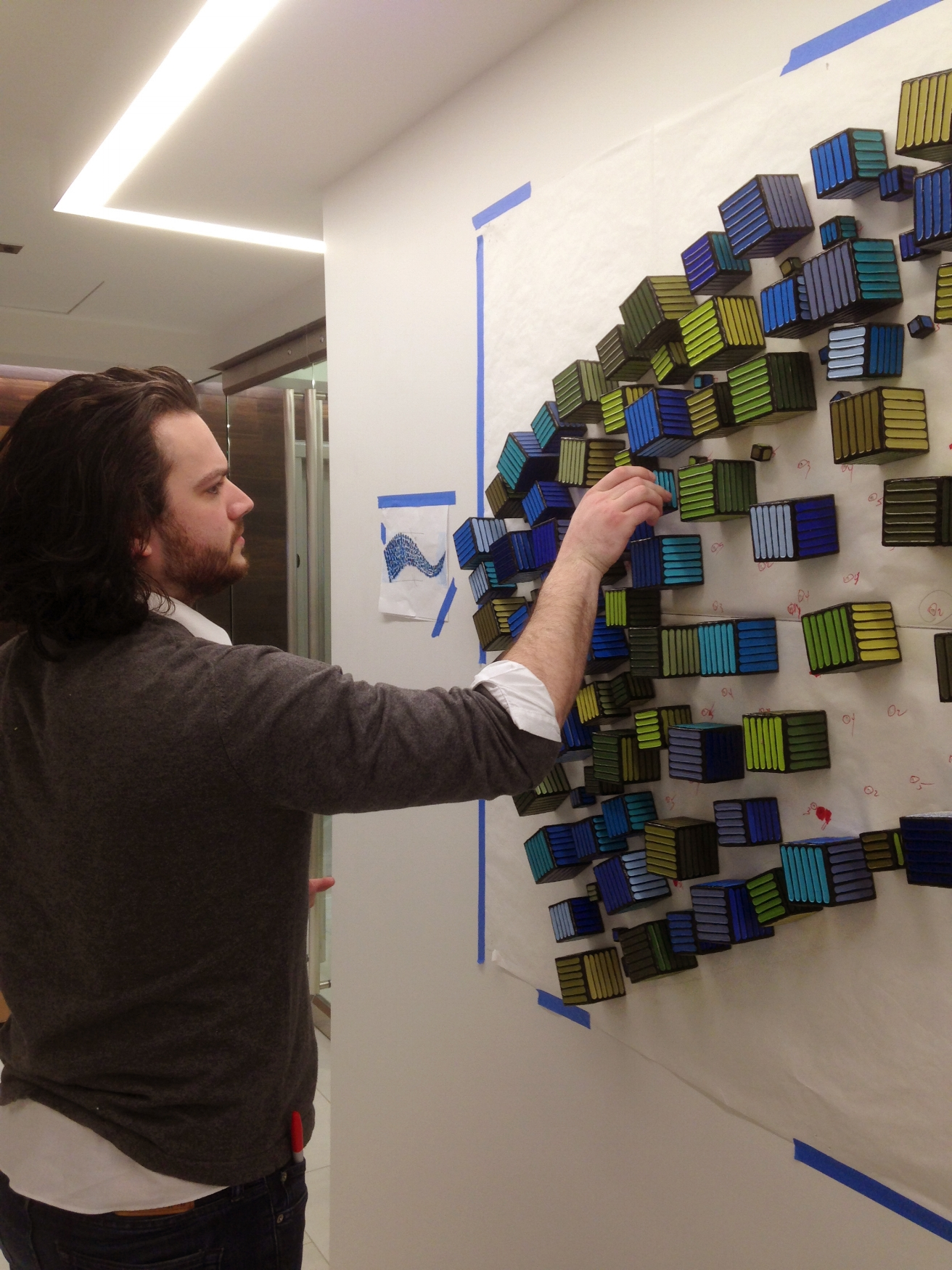 Just a few days into the job, Keenan is installing a complex wall sculpture for one of our clients in Bethesda.