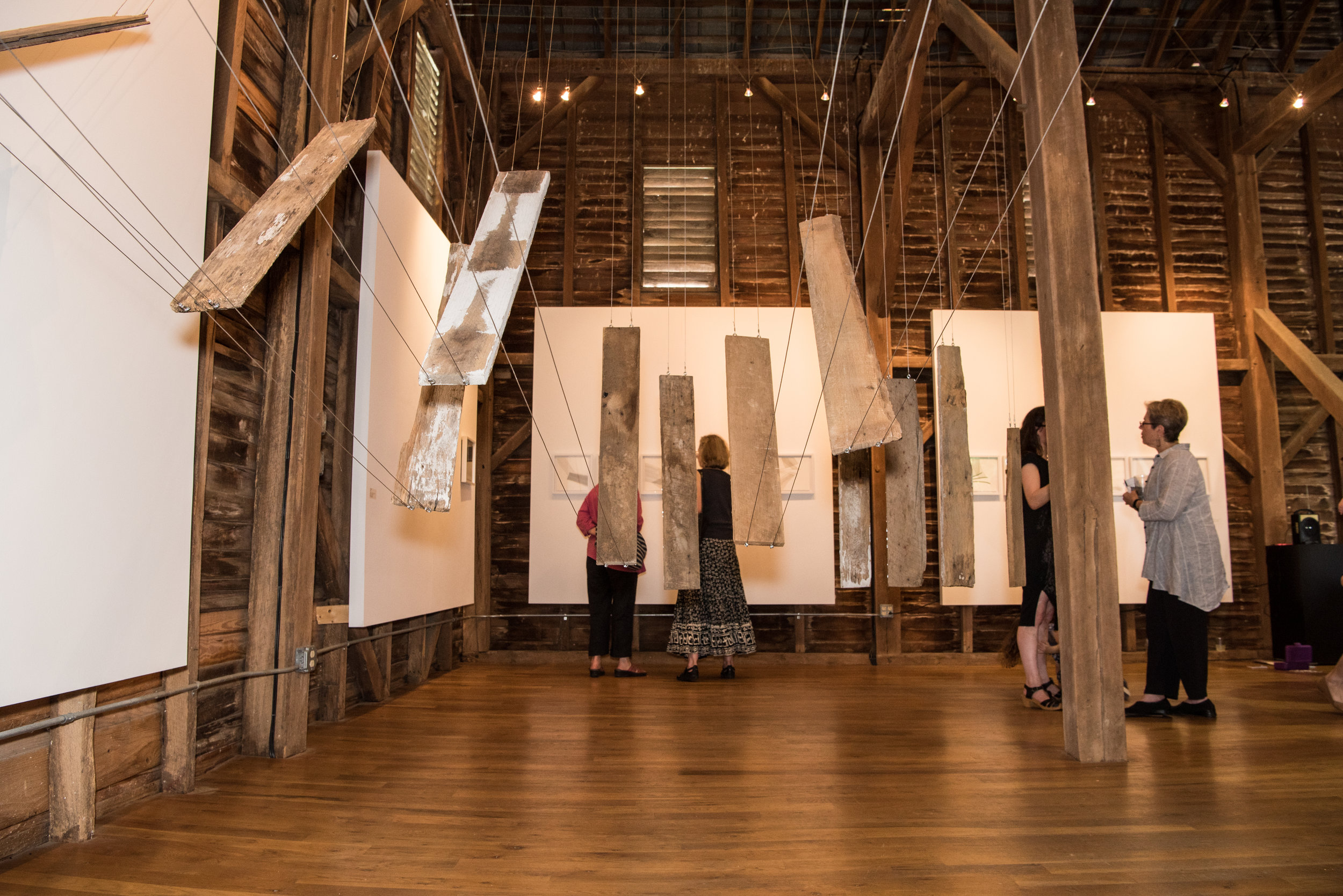 Sarah Hardesty's work interacts with the barn's finishes.