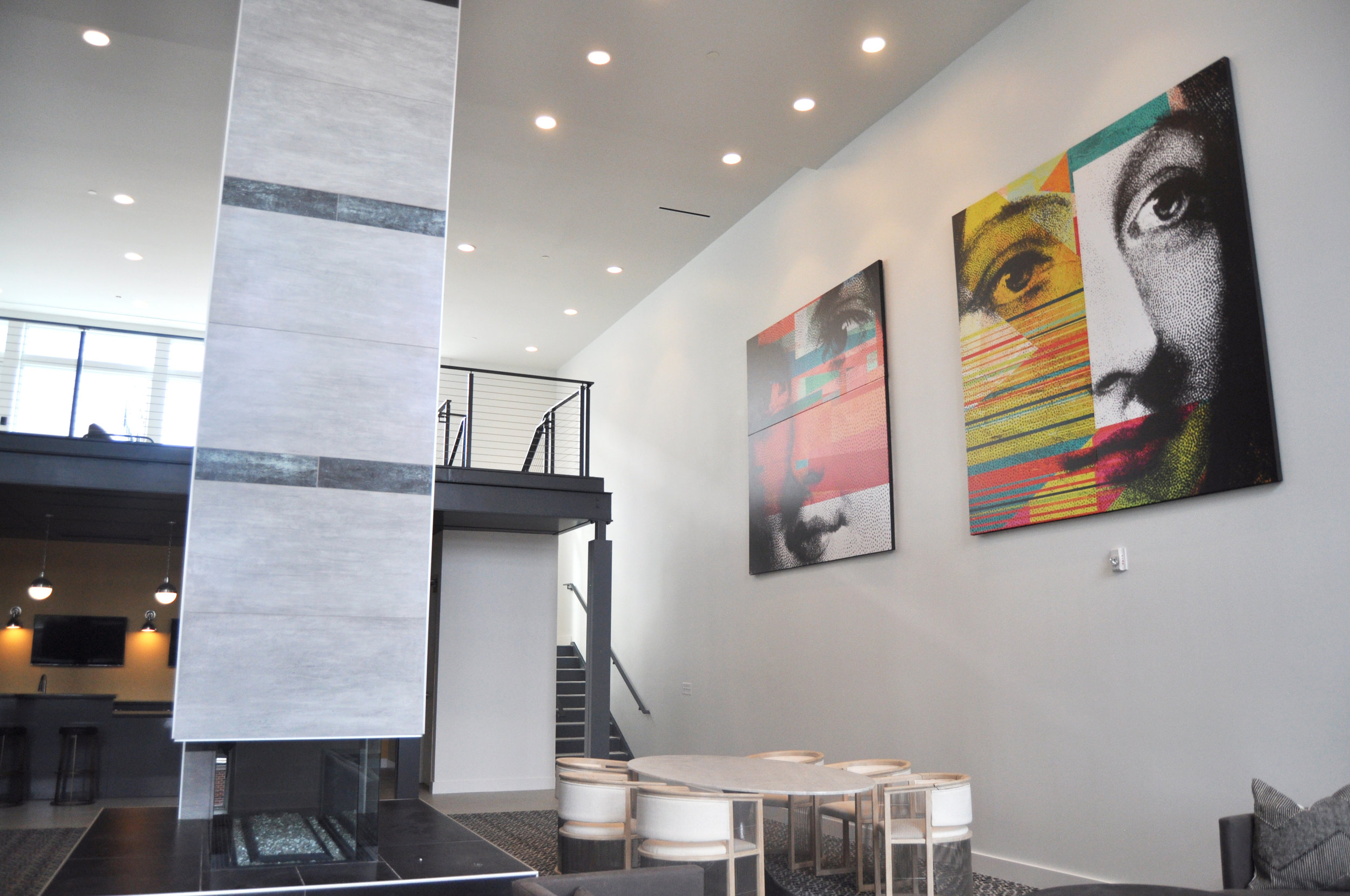 Two huge 8x8 foot canvases adorn a tall wall in the Community Lounge.