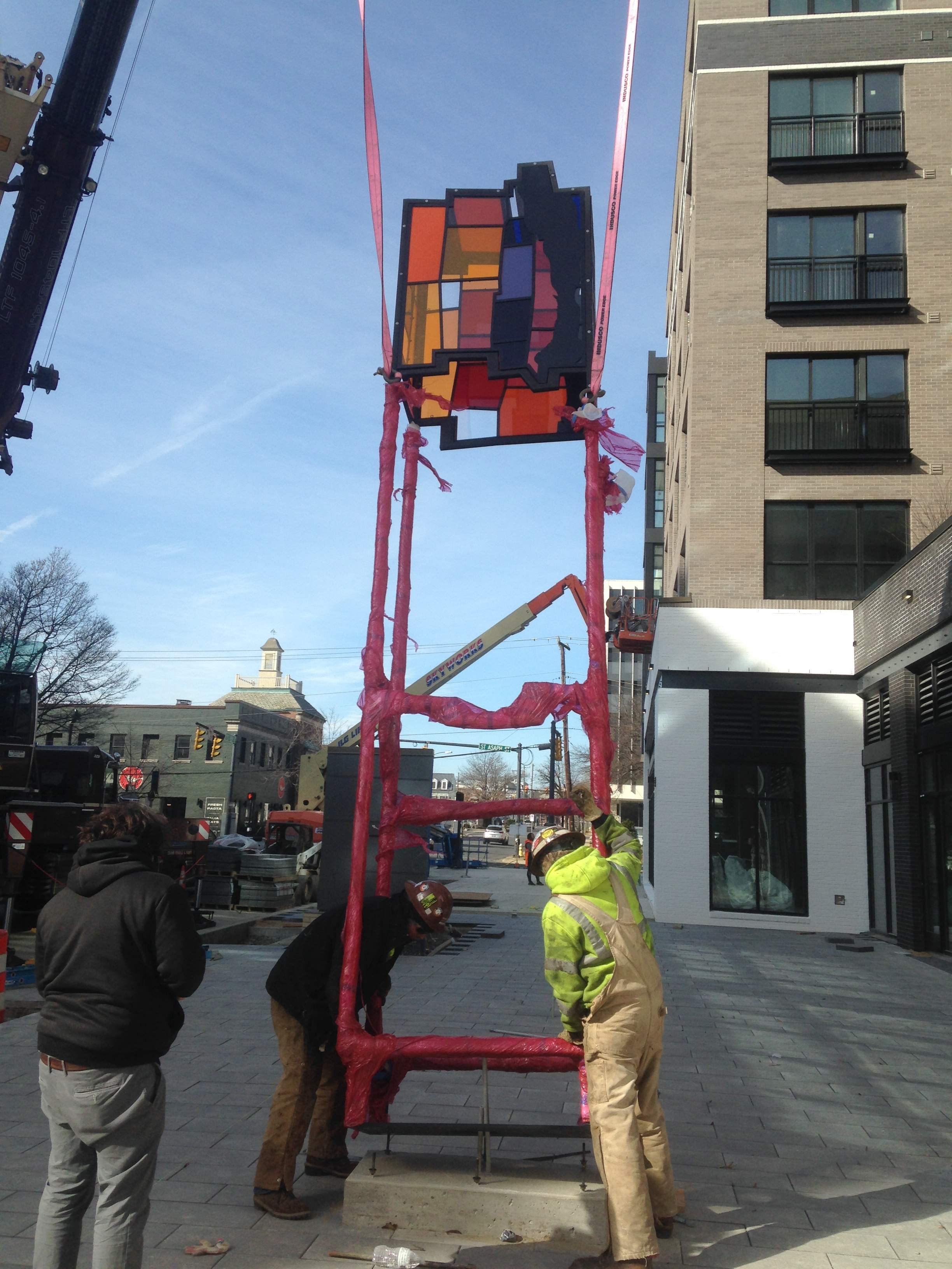 Raising the sculpture on-site with some panels installed.