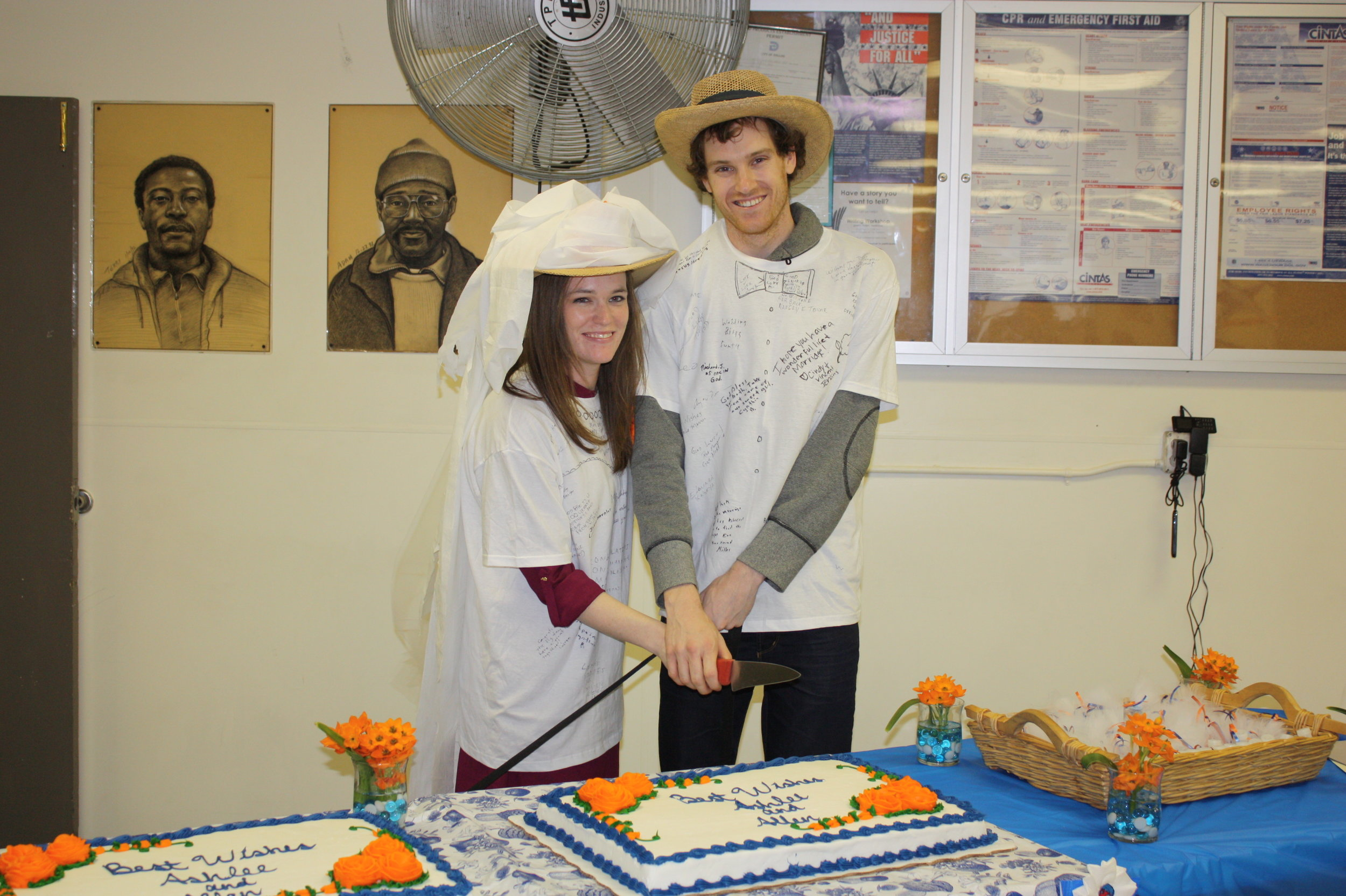 The happy couple cutting their cake at The Stewpot