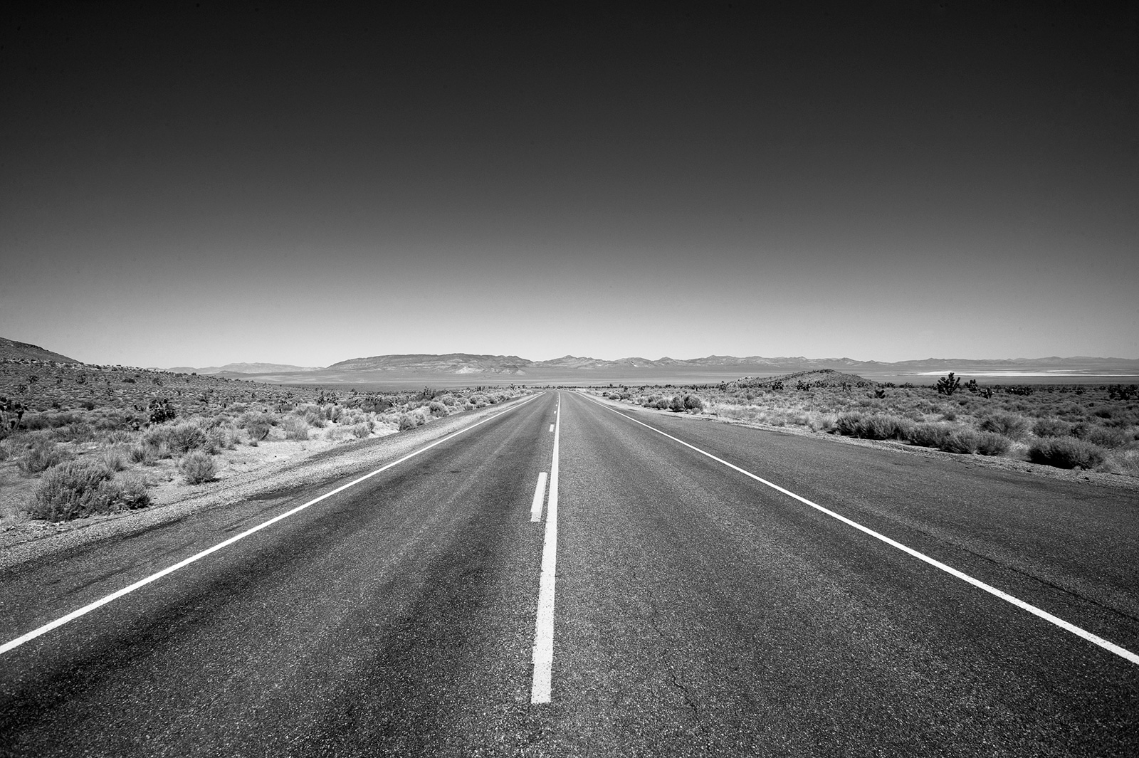 Define the shoulders of the road ahead.