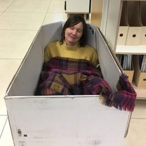 "Here I am happily doing some ""creative thinking"" in the office... Because it's as important to find time to think inside the box as outside of it!"