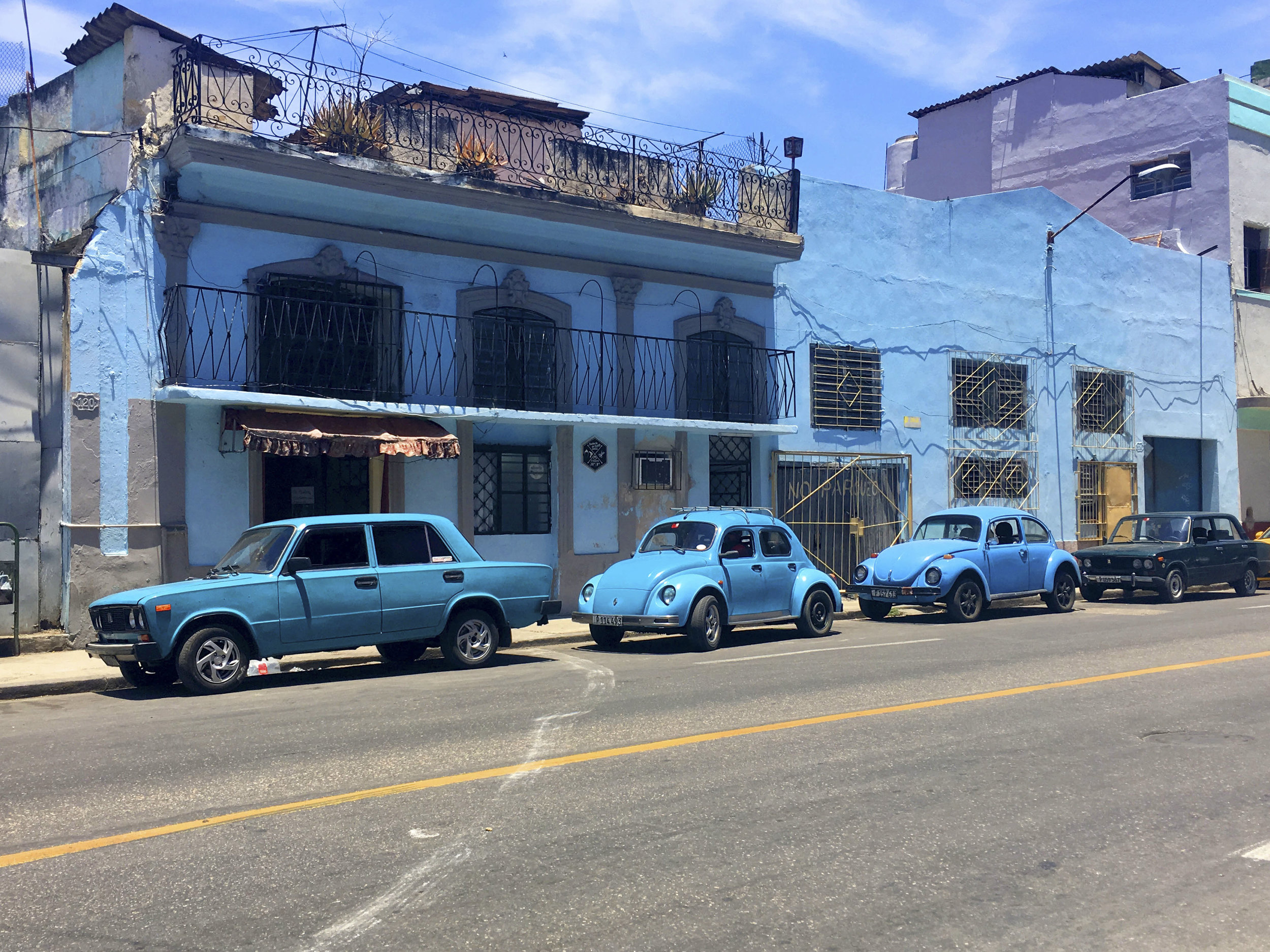 Cuba- Havana- Colorful vintage cars in the streets