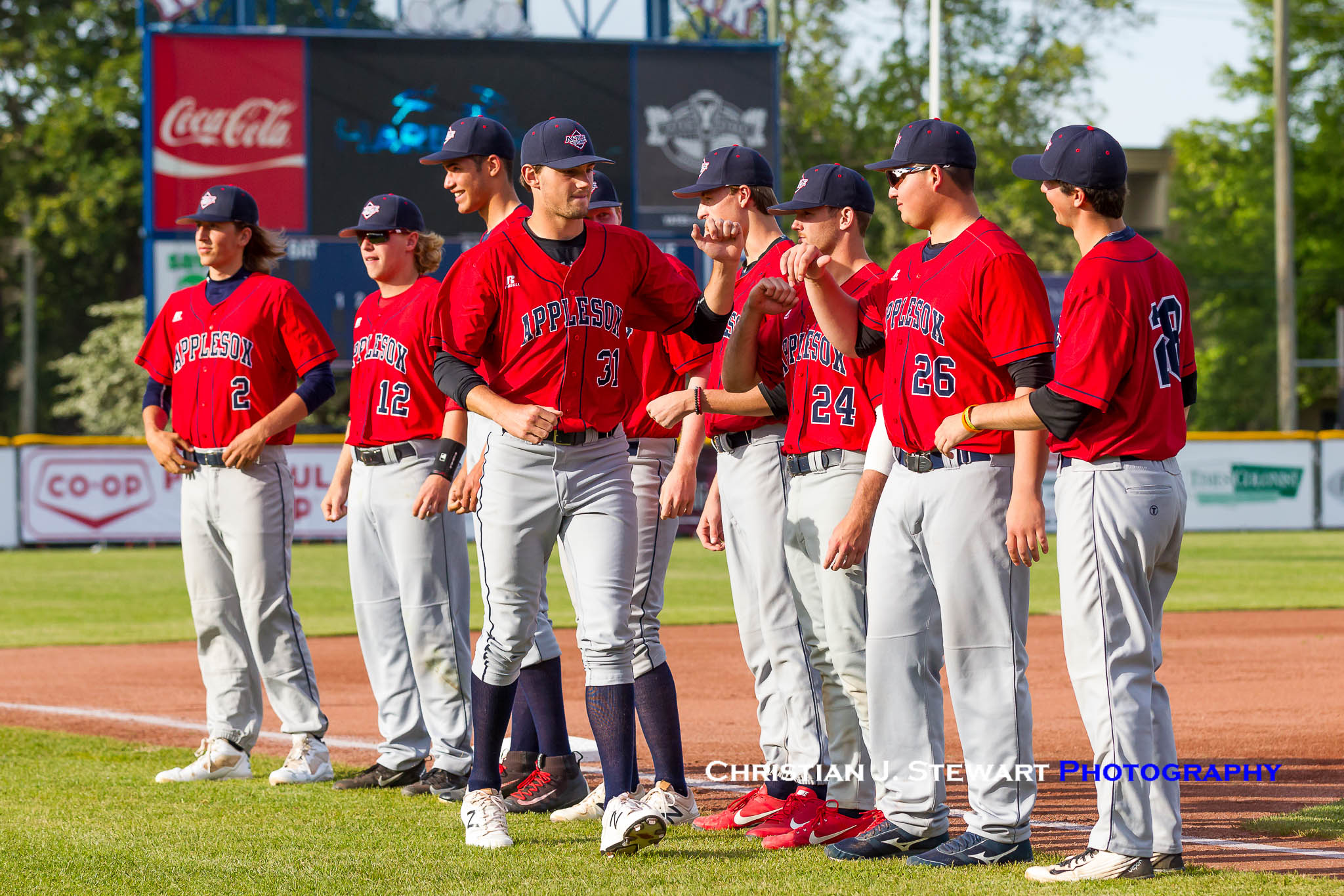 Photo Courtesy of Christian J. Stewart Photography -  Dylan Grogan bumps fist with AppleSox teammates before June 5 game at Victoria. The AppleSox won 9-4.