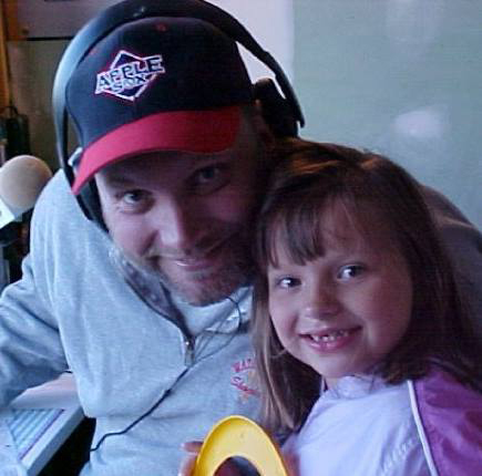 Eric Granstrom, the 'Voice of the AppleSox' from 2000-06, will broadcast four Sox games for the NCWLIFE Channel this summer. Here he is pictured with his daughter, Gracie, in the broadcast booth in 2003.