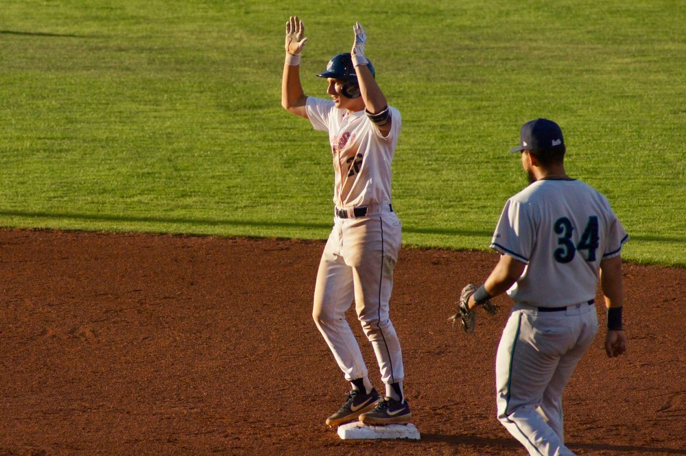 Infielder Kody Darcy performs the Sox' popular 'All Hail the Queen' celebration after hitting a double in a recent home game.