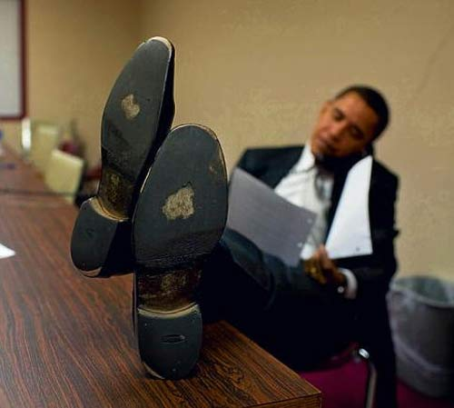 obama feet shoes table