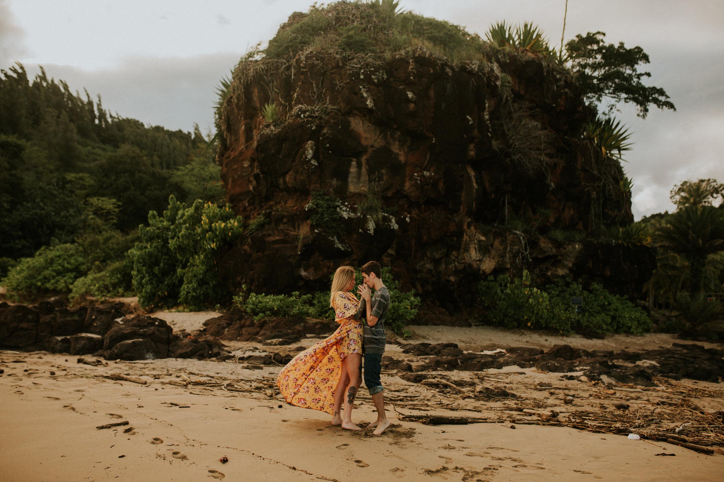 kauai engagement photos allerton garden near spouting horn in poipu